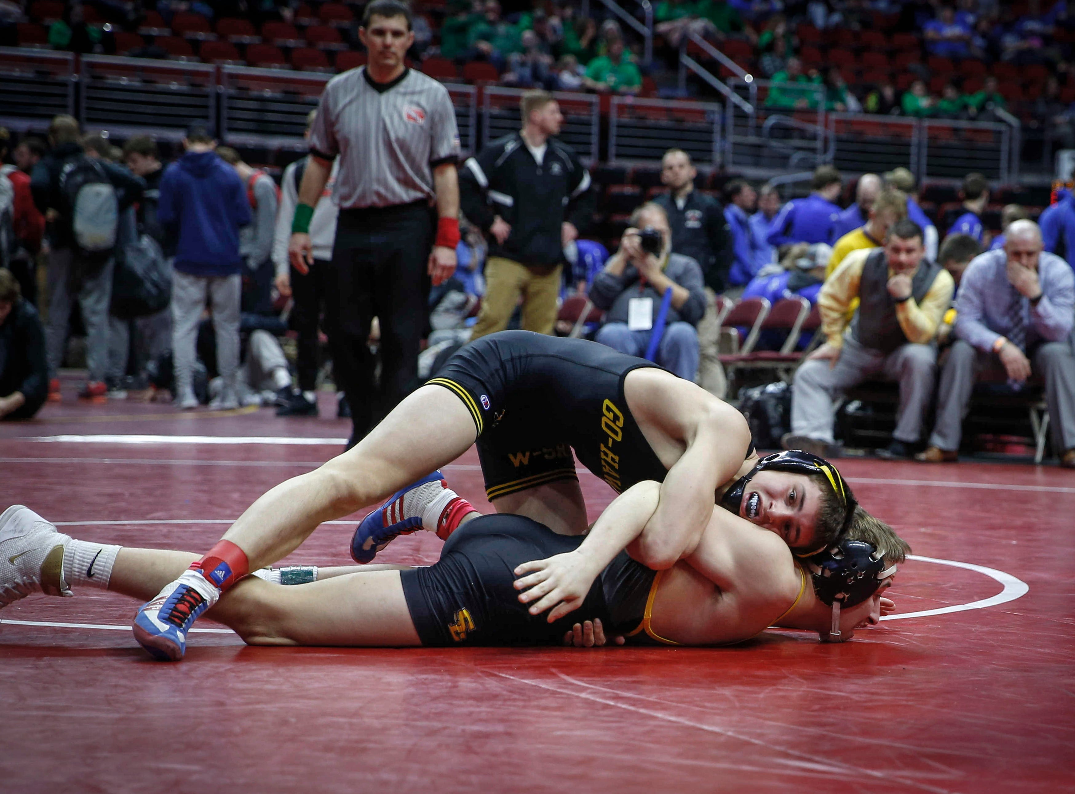 Waverly-Shell Rock's Evan Yant works to control Southeast Polk's Carson Martinson at 132 pounds during the 2019 Iowa high school dual wrestling state tournament on Wednesday, Feb. 13, 2019, at Wells Fargo Arena in Des Moines.