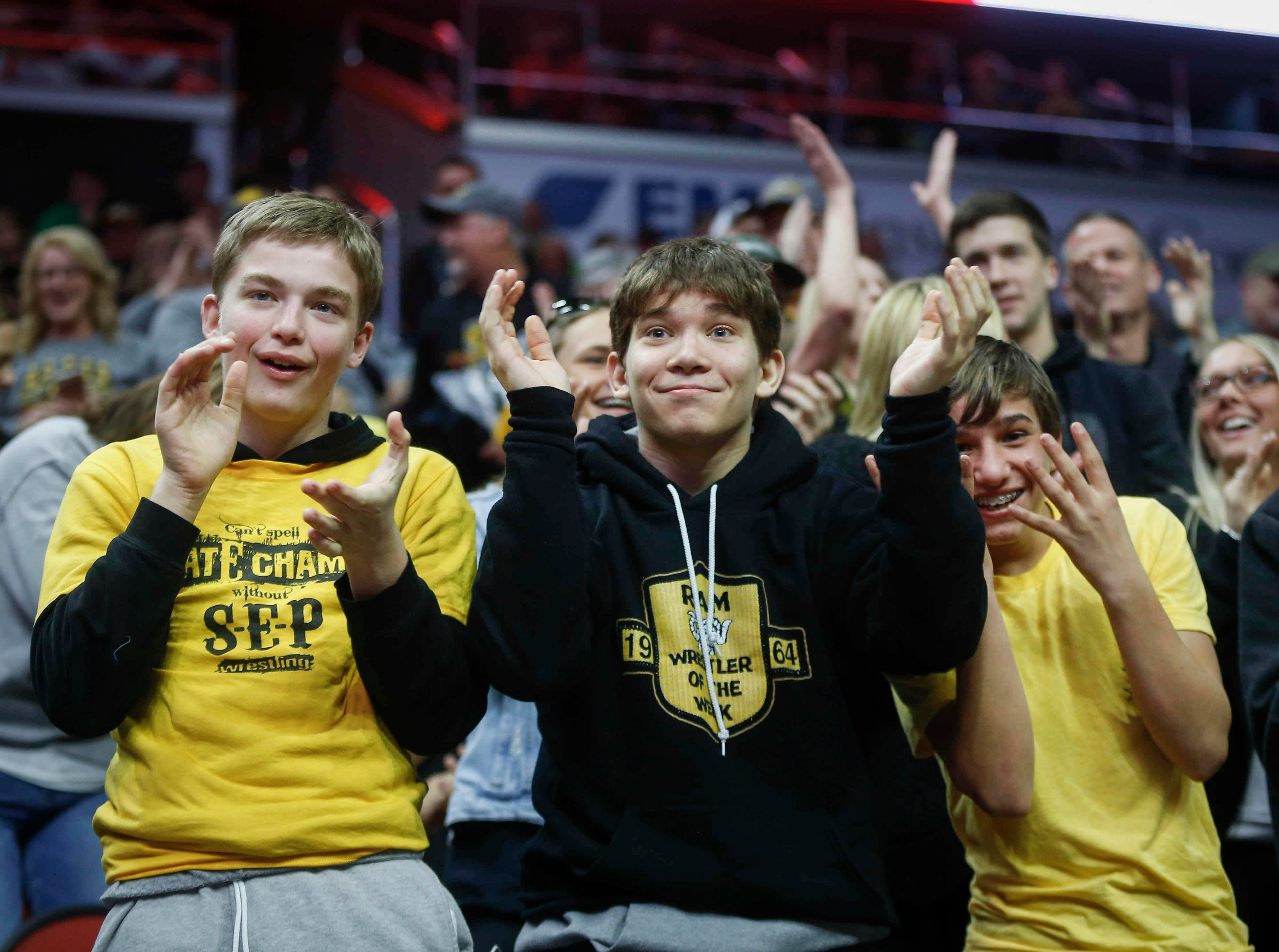 Southeast Polk high school fans cheer as Lance Runyon spent all of nine seconds before pinning Waverly-Shell Rock's Kurt Fay during the 2019 Iowa high school dual wrestling state tournament on Wednesday, Feb. 13, 2019, at Wells Fargo Arena in Des Moines.