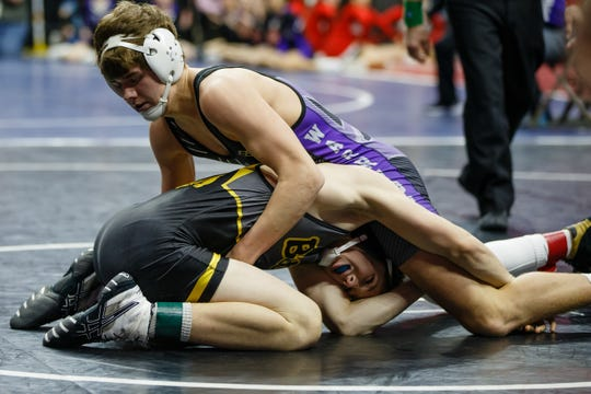 Norwalk's Carter Schmidt controls Bettendorf's Bradley Hill during their 152-pound match Thursday at the state wrestling tournament.