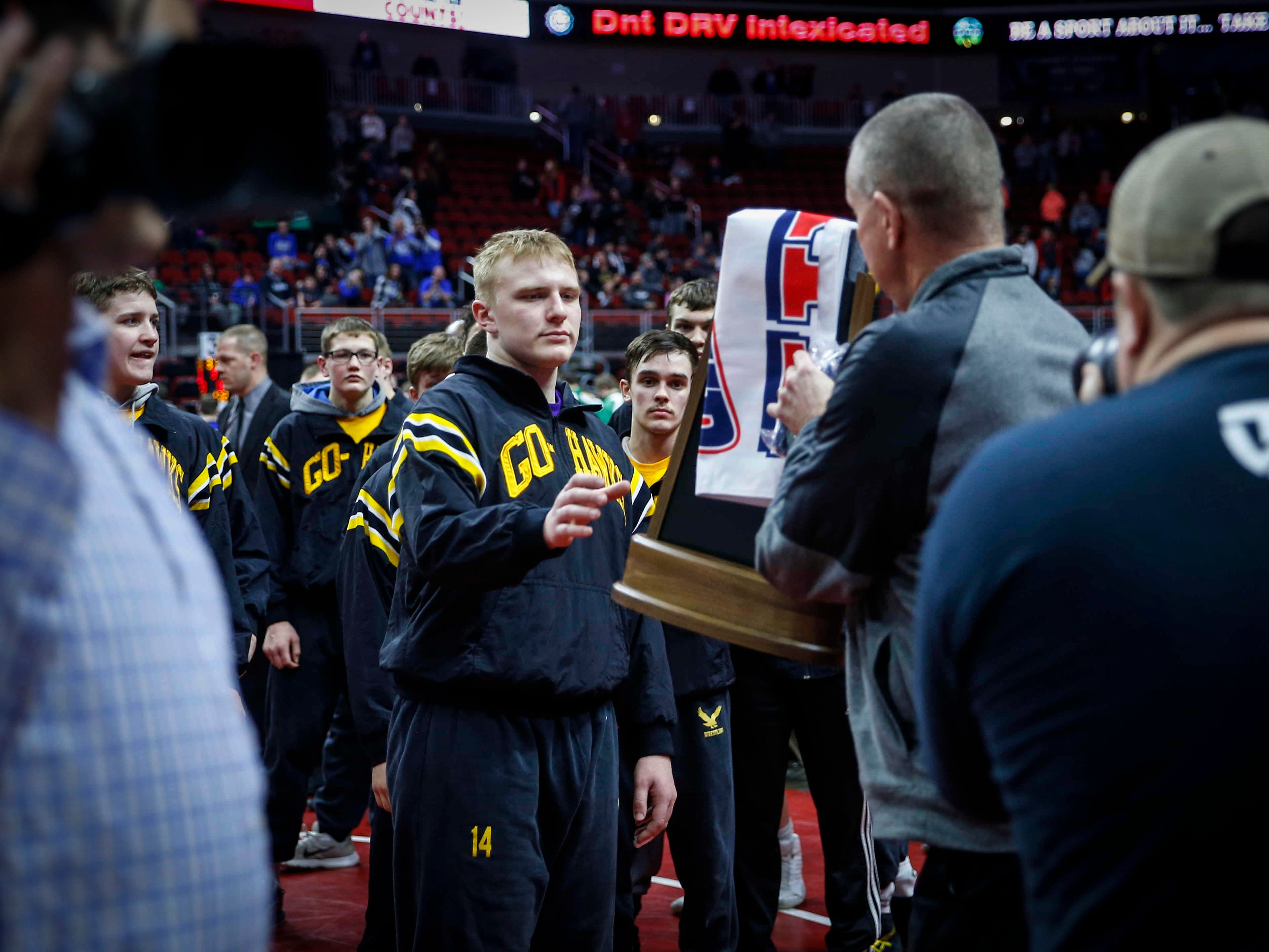 Members of the Waverly-Shell Rock wrestling team take the Class 3A runner up trophy during the 2019 Iowa high school dual wrestling state tournament on Wednesday, Feb. 13, 2019, at Wells Fargo Arena in Des Moines.