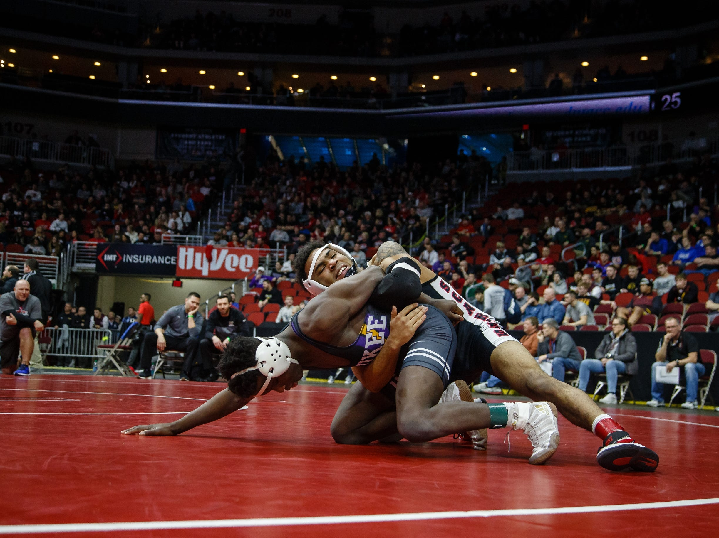 Deville Dentis of Des Moines East wrestles Jermaine Sammler of Wakee during their 3A 145 lb match at the state wrestling tournament on Thursday, Feb. 14, 2019 in Des Moines.