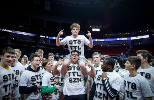 Members of the Southeast Polk wrestling team celebrate a Class 3A state title win over Waverly-Shell Rock during the 2019 Iowa high school dual wrestling state tournament on Wednesday, Feb. 13, 2019, at Wells Fargo Arena in Des Moines.