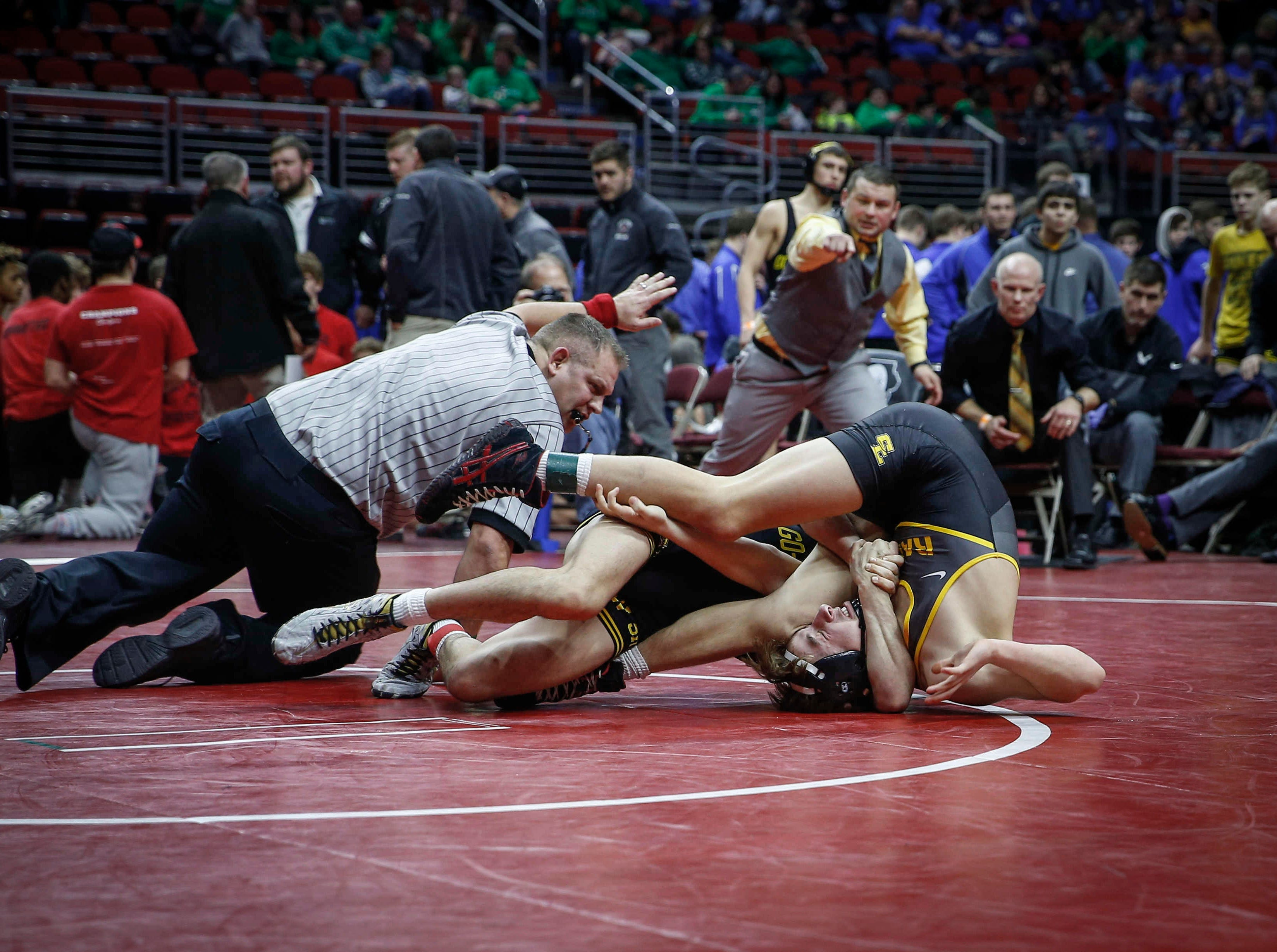 Waverly-Shell Rock's Dylan Albrecht pins Southeast Polk's Carter Martinson at 126 pounds during the 2019 Iowa high school dual wrestling state tournament on Wednesday, Feb. 13, 2019, at Wells Fargo Arena in Des Moines.