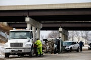 A Hy-Vee catering van sits on its side after it was driven off the road on Thursday, Feb. 14, 2019 in Des Moines.