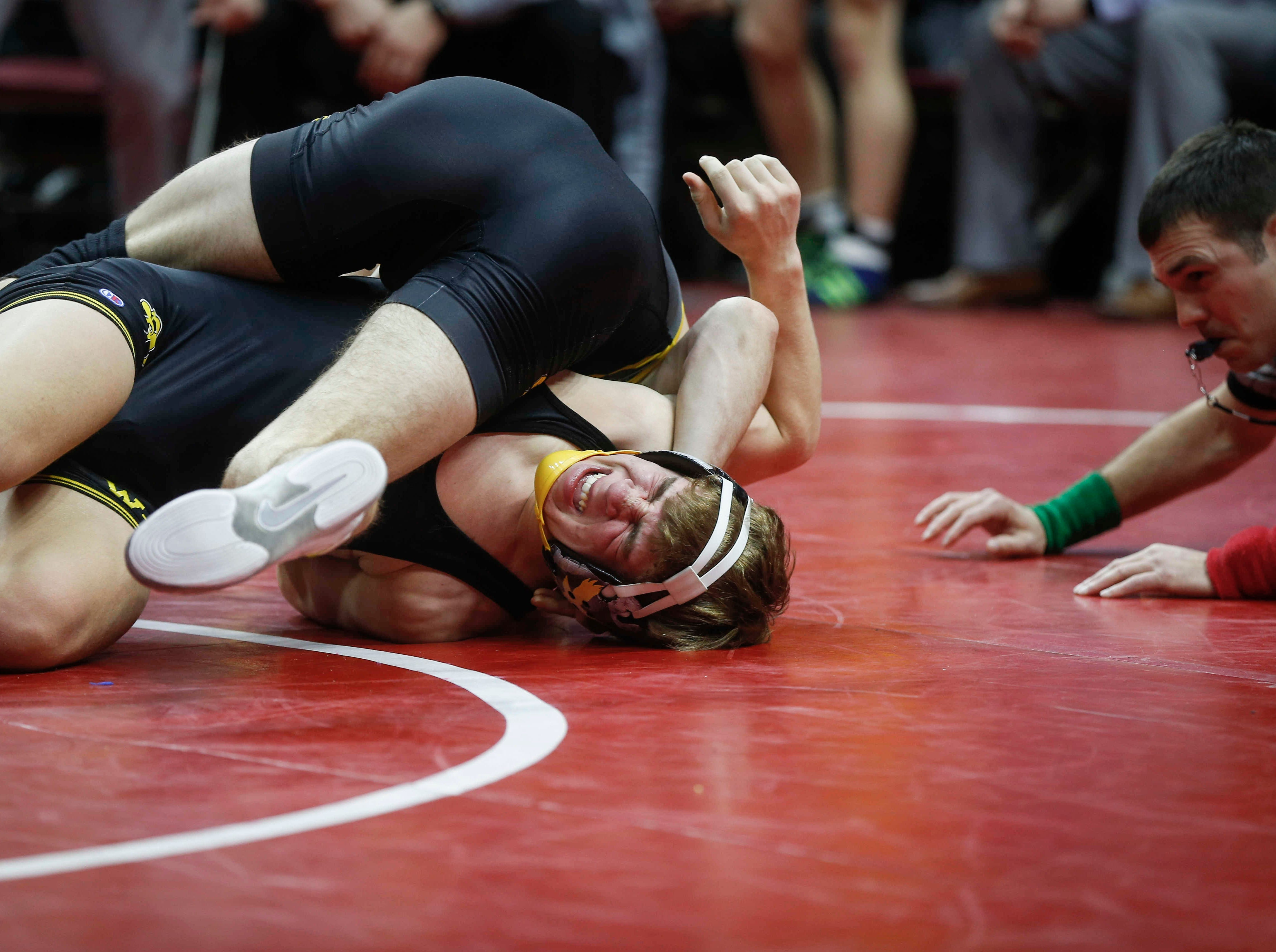 Southeast Polk's Camden Baarda collects back points on  Waverly-Shell Rock's Cayden Langreck at 145 pounds during the 2019 Iowa high school dual wrestling state tournament on Wednesday, Feb. 13, 2019, at Wells Fargo Arena in Des Moines.