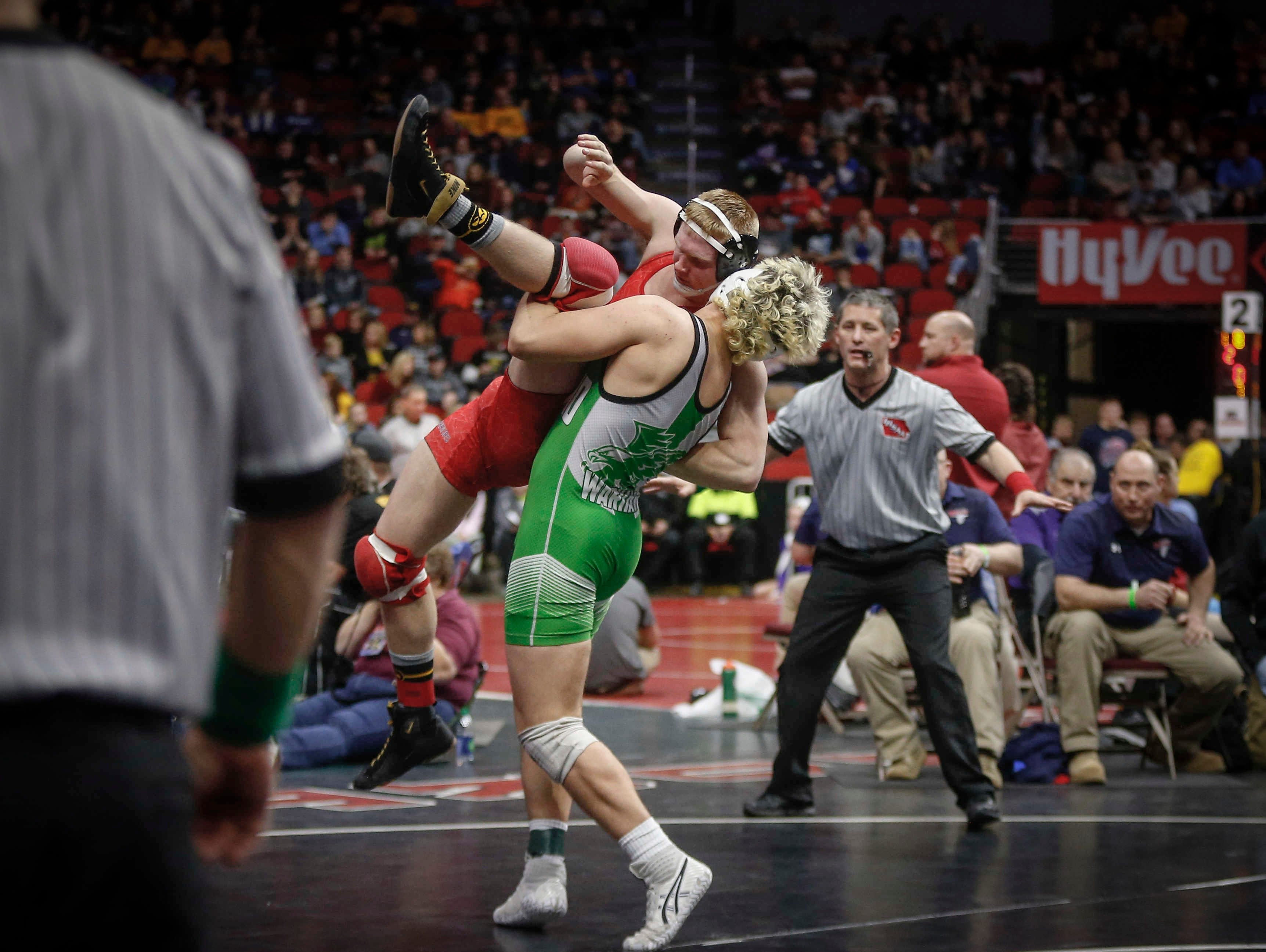 Southeast Warren senior Colby Page takes Alta-Aurelia sophomore Alex De Roos down to the mat in their match at 182 pounds during the opening round of Class 1A matches during the Iowa high school state wrestling tournament at Wells Fargo Arena on Thursday, Feb. 14, 2019, in Des Moines.