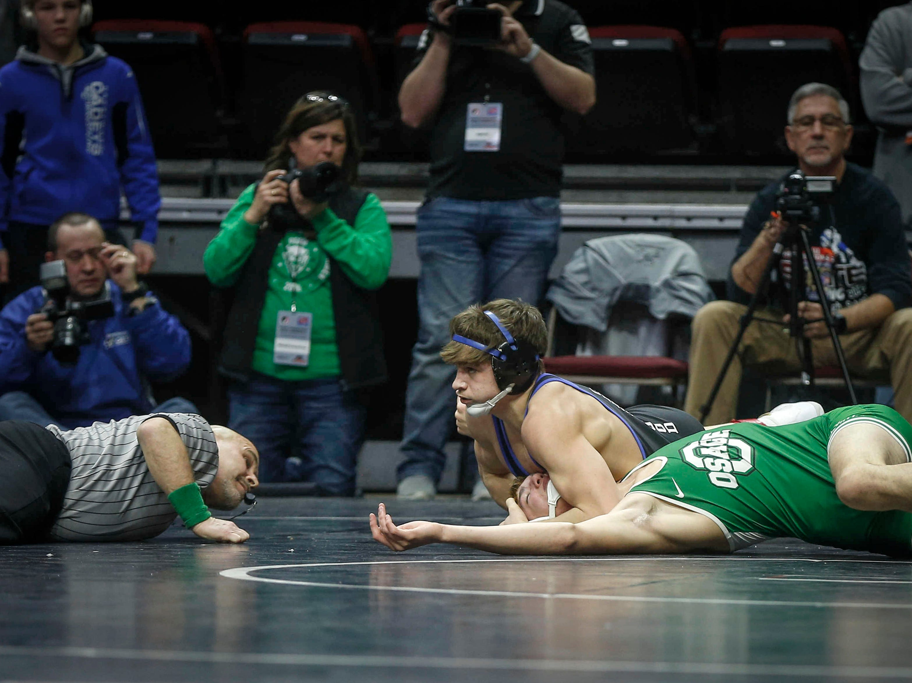 Crestwood's Colter Bye pins Osage's Owen Muller at 182 pounds during the 2019 Iowa high school dual wrestling state tournament on Wednesday, Feb. 13, 2019, at Wells Fargo Arena in Des Moines.