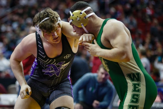 Norwalk's Nate Heckart wrestles Landon Green of Iowa City West in a 220-pound match Thursday at the state wrestling tournament.
