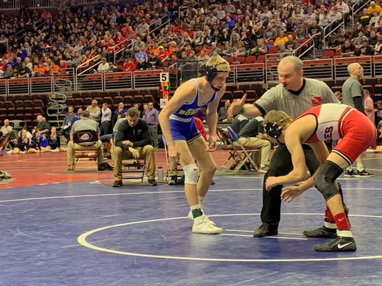 Don Bosco 132-pound wrestler Easton Larson begins his Class 1A first-round match against Geoff Streb of Highland (Riverside) on Thursday at Wells Fargo Arena in Des Moines. Larson won his match by pin to advance to the quarterfinals.