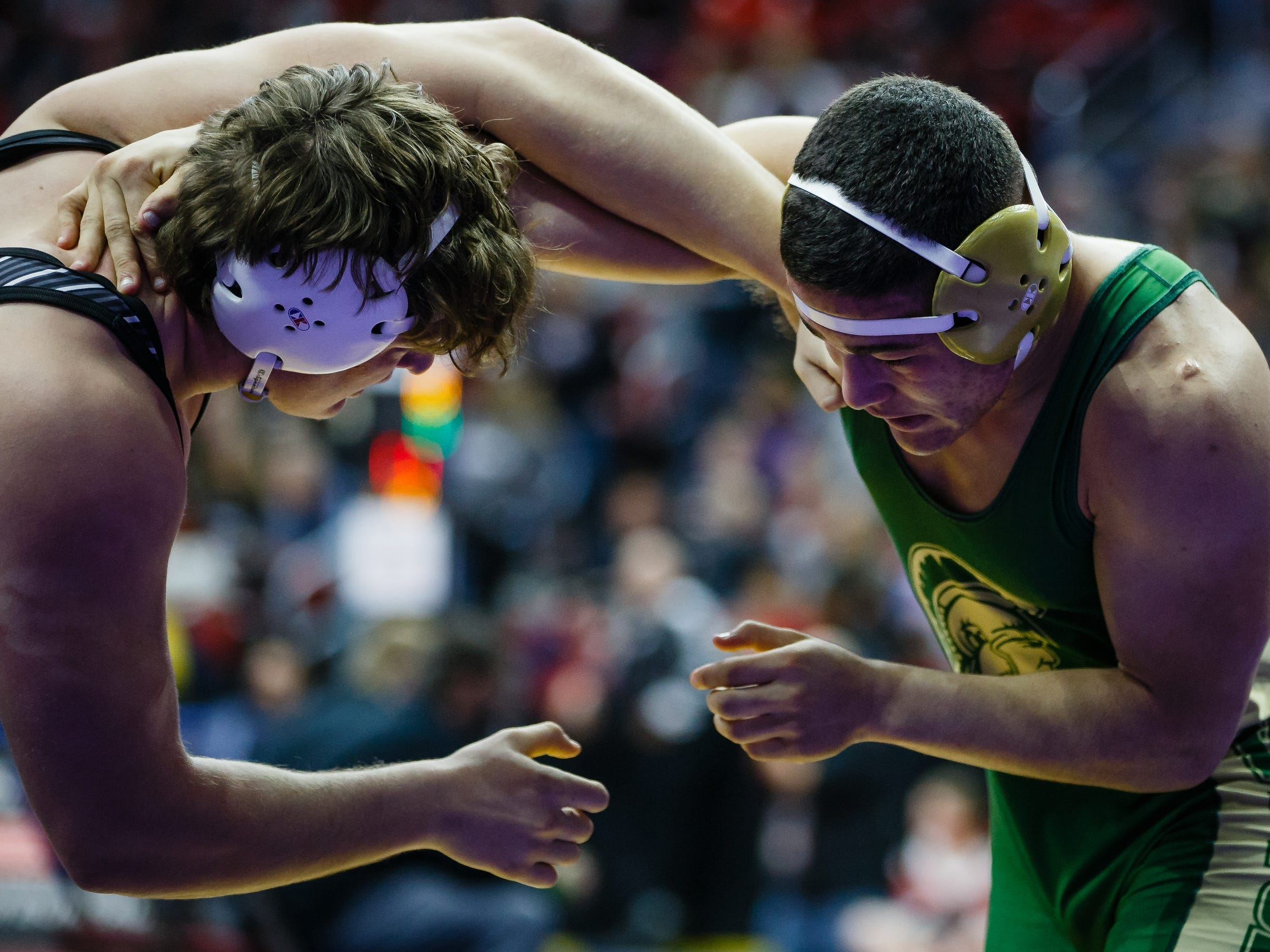 Landon Green of Iowa City, West wrestles Nate Heckart of Norwalk during their 3A 220 lb match at the state wrestling tournament on Thursday, Feb. 14, 2019 in Des Moines.