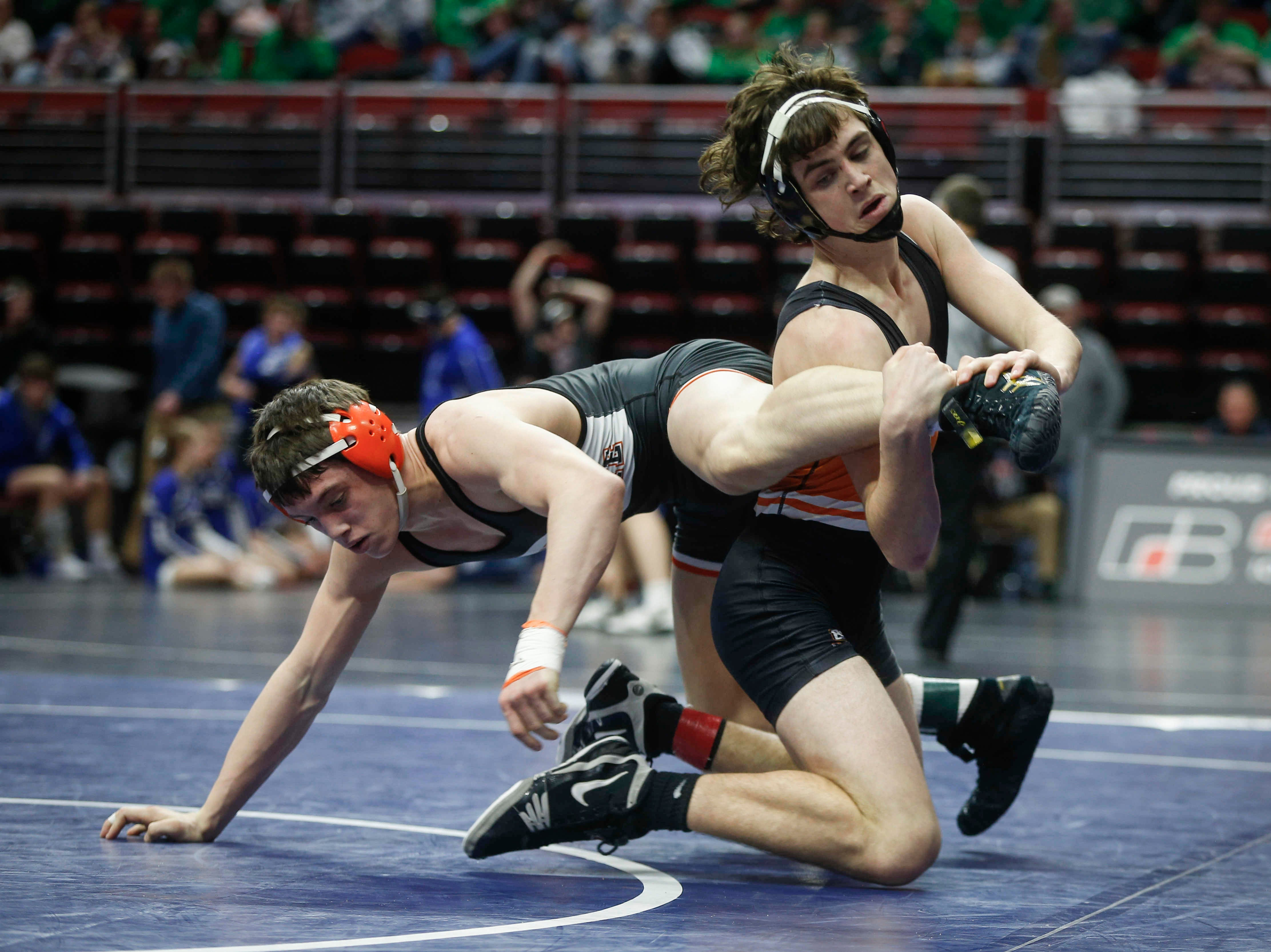 Solon's Andy Brokaw, right, pulls away from West Delaware's Wyatt Voelker in their match at 170 during the 2019 Iowa high school dual wrestling state tournament on Wednesday, Feb. 13, 2019, at Wells Fargo Arena in Des Moines.