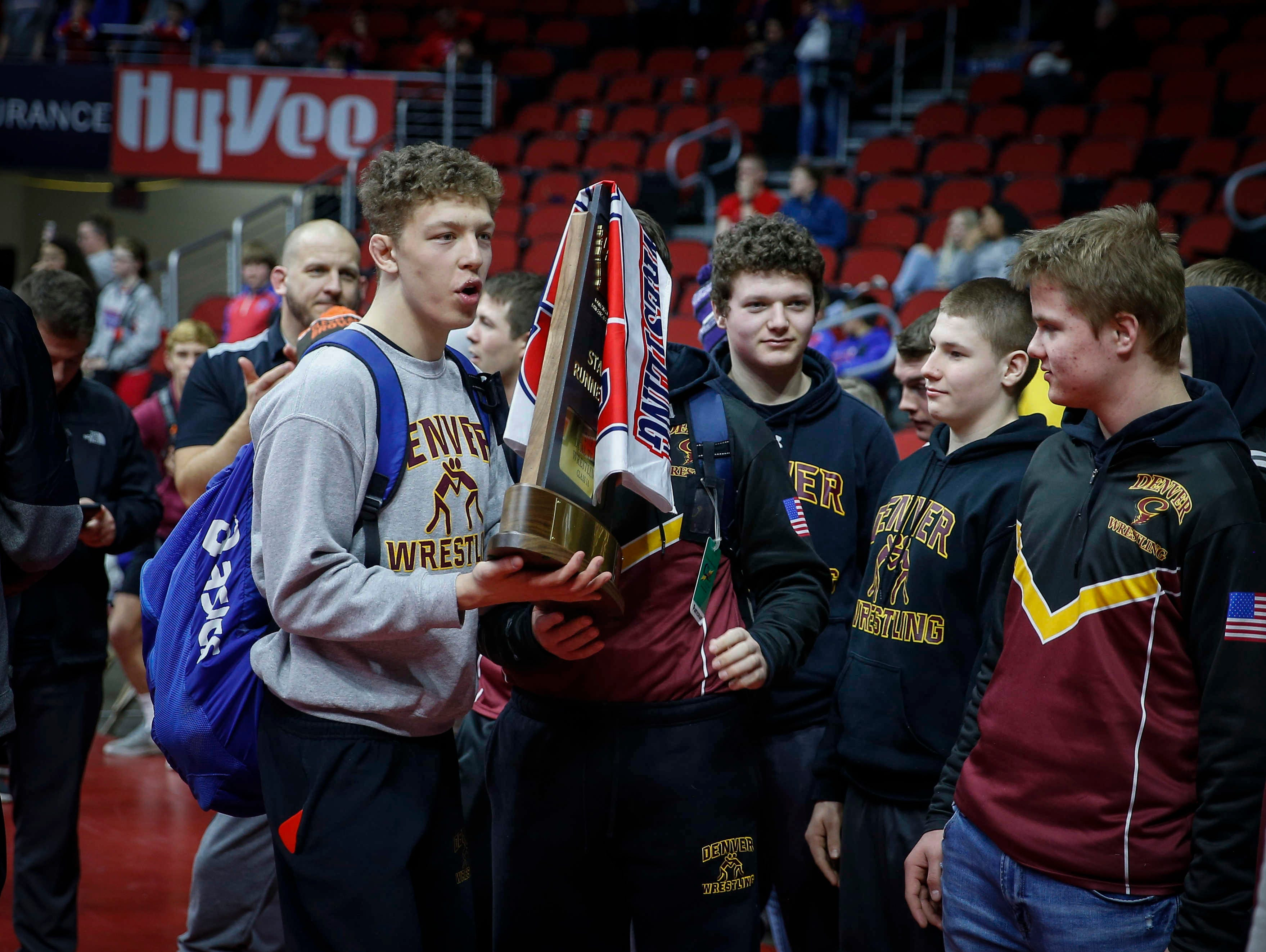 Members of the Denver wrestling team hold the Class 1A runner up trophy during the 2019 Iowa high school dual wrestling state tournament on Wednesday, Feb. 13, 2019, at Wells Fargo Arena in Des Moines.