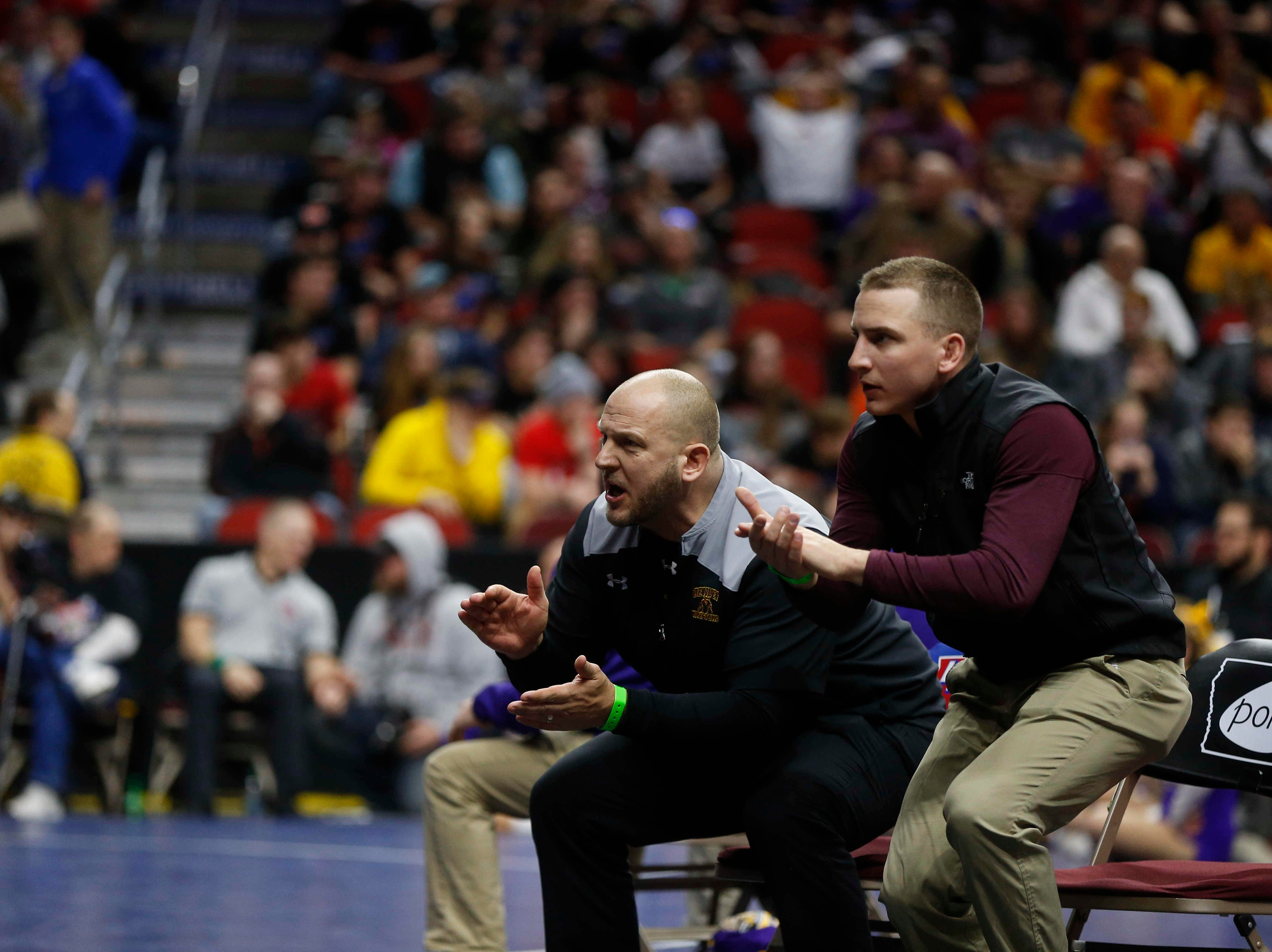 Denver coaches explode out of their seats as Cael Krueger wrestles Western Christian sophomore Tristan Mulder at 170 pounds during the opening round of Class 1A matches during the Iowa high school state wrestling tournament at Wells Fargo Arena on Thursday, Feb. 14, 2019, in Des Moines.