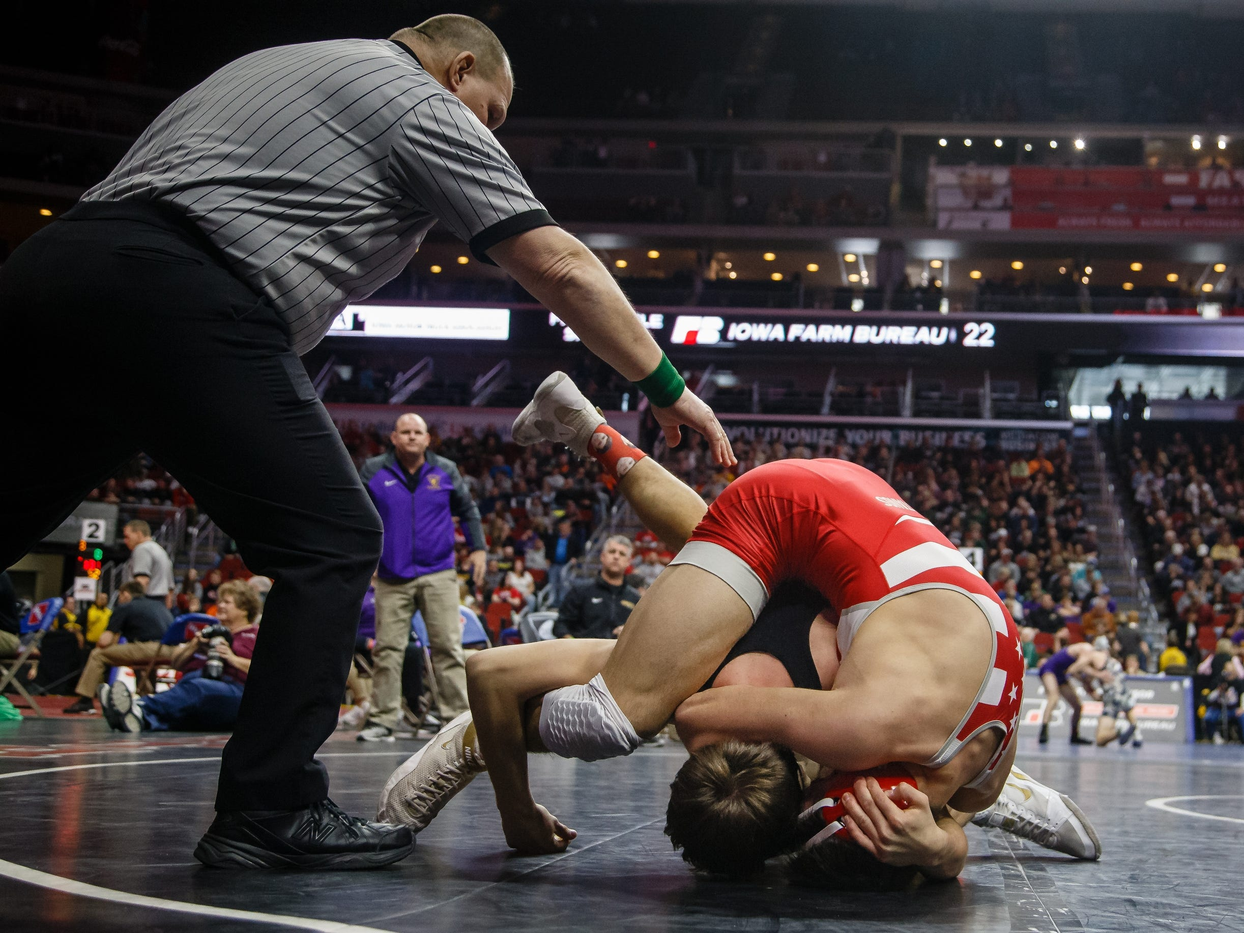 Cade Moss of Johnston wrestles Bain Broderick of Dallas Center- Grimes during their 3A 152 lb match at the state wrestling tournament on Thursday, Feb. 14, 2019 in Des Moines.
