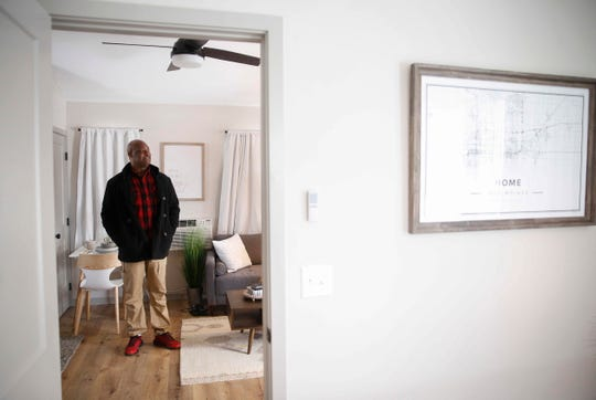 Will Winder of Des Moines looks around his new home on Thursday, Feb. 14, 2019, in Des Moines.