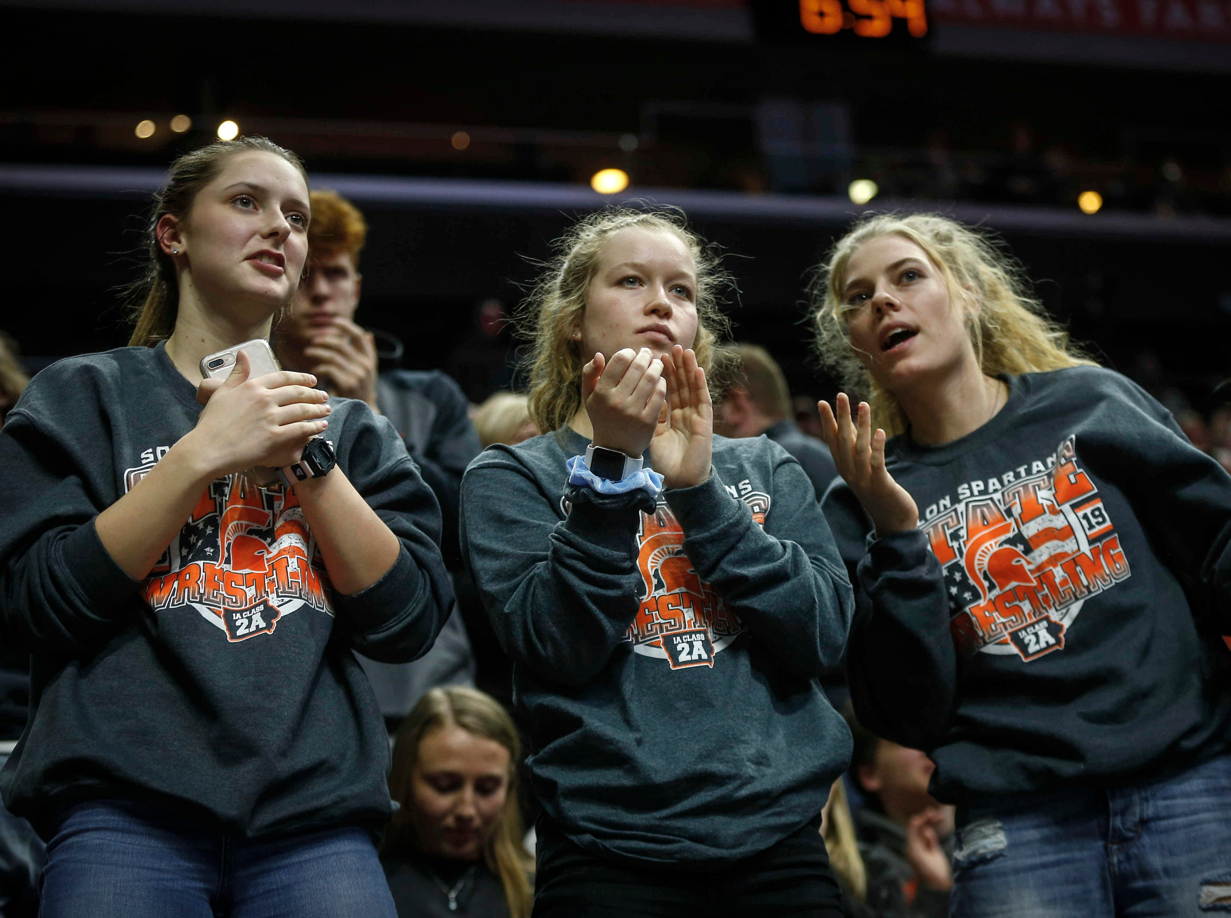 Solon fans cheer during the 2019 Iowa high school dual wrestling state tournament on Wednesday, Feb. 13, 2019, at Wells Fargo Arena in Des Moines.