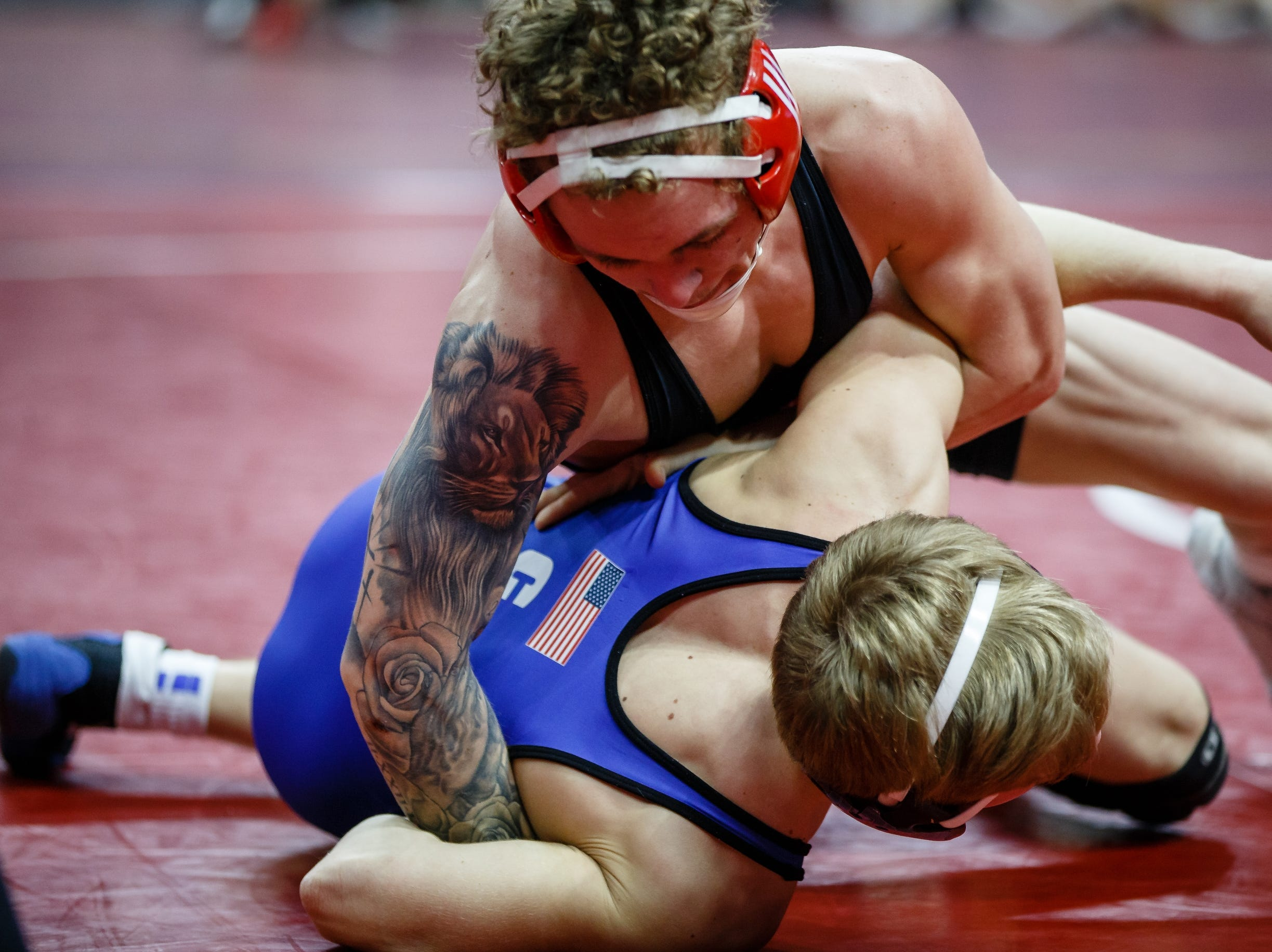 Samual Stevens of Clear Creek-Amana wrestles Matthew Jordan of Des Moines East during their 3A 126 lb match at the state wrestling tournament on Thursday, Feb. 14, 2019 in Des Moines.