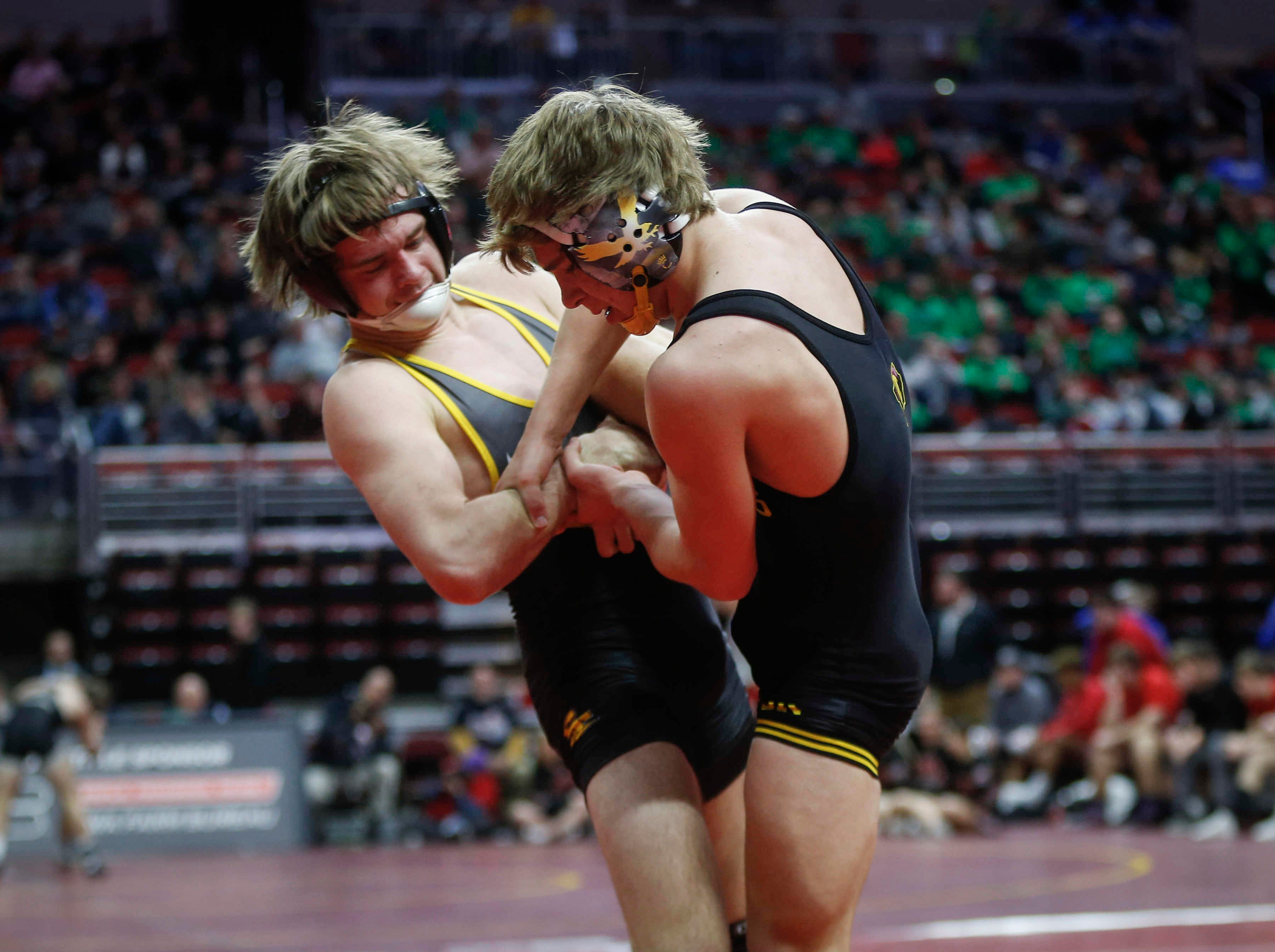 Southeast Polk's Camden Baarda, left, controls Waverly-Shell Rock's Cayden Langreck at 145 pounds during the 2019 Iowa high school dual wrestling state tournament on Wednesday, Feb. 13, 2019, at Wells Fargo Arena in Des Moines.