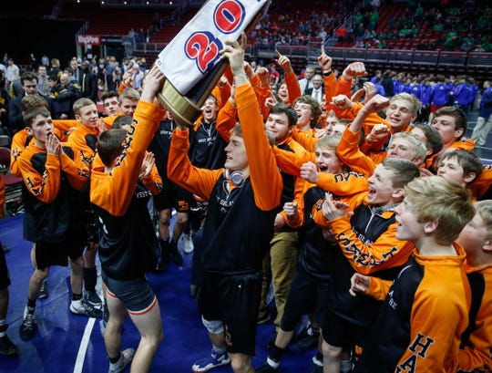 Members of the West Delaware wrestling team celebrate a Class 2A title during the 2019 Iowa high school dual wrestling state tournament on Wednesday, Feb. 13, 2019, at Wells Fargo Arena in Des Moines.