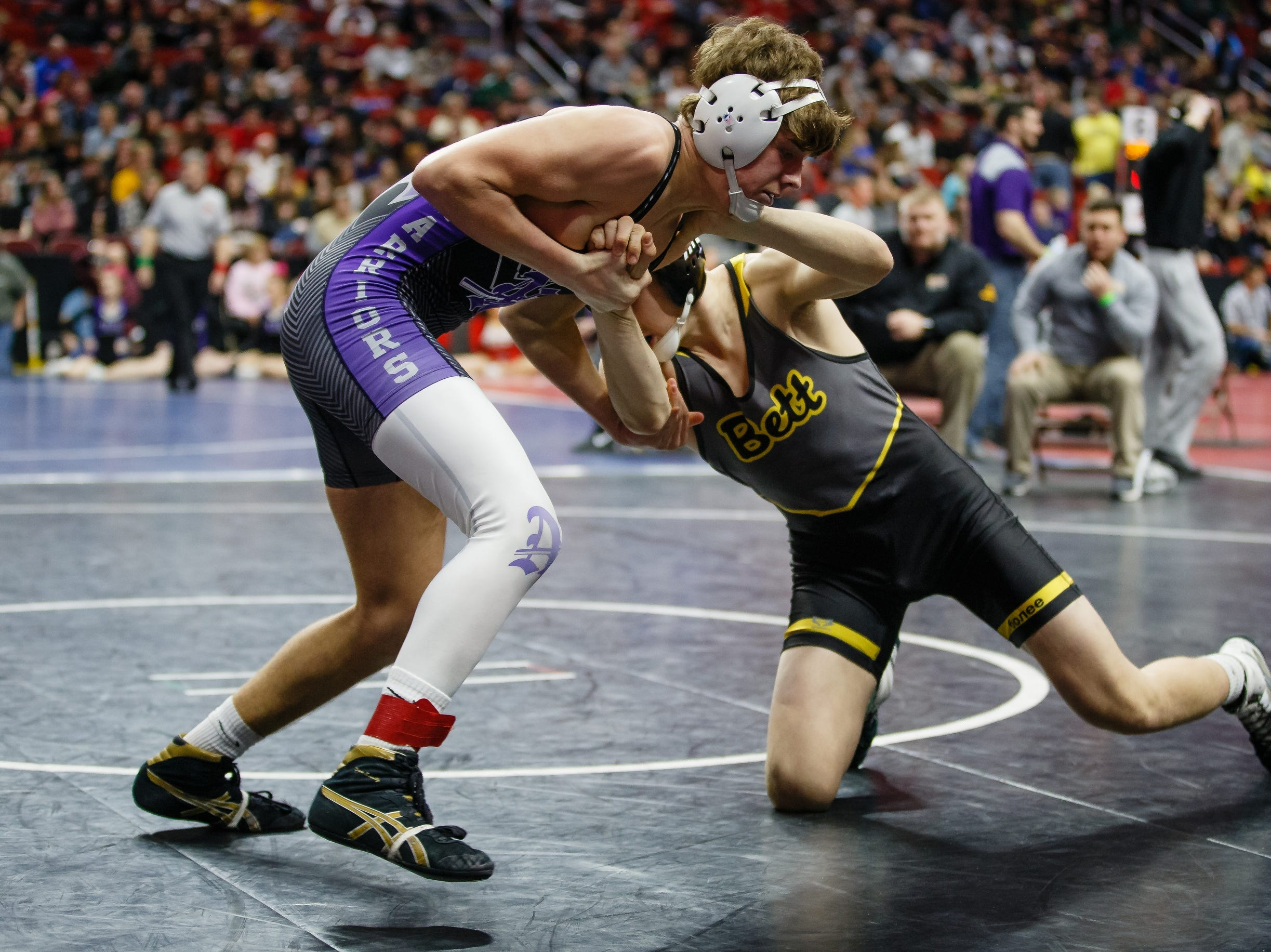 Bradley Hill from Bettendorf wrestles Carter Schmidt from Norwalk during their 3A 152 lb match at the state wrestling tournament on Thursday, Feb. 14, 2019 in Des Moines.
