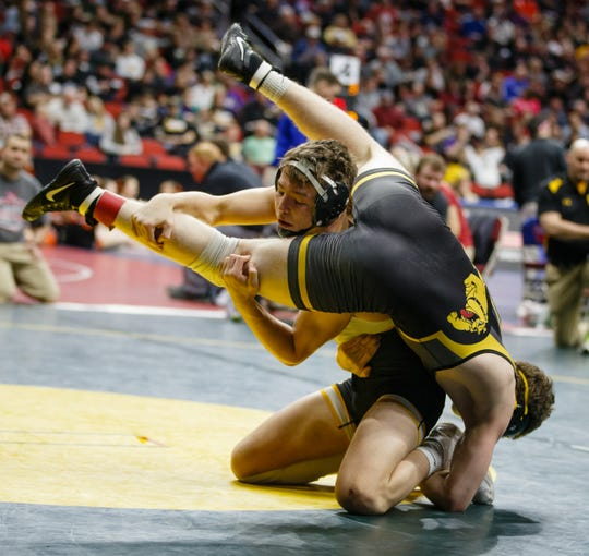 Cade DeVos of Southeast Polk wrestles Voyen Adamson of Bettendorf during their 3A 160 lb match at the state wrestling tournament on Thursday, Feb. 14, 2019 in Des Moines.