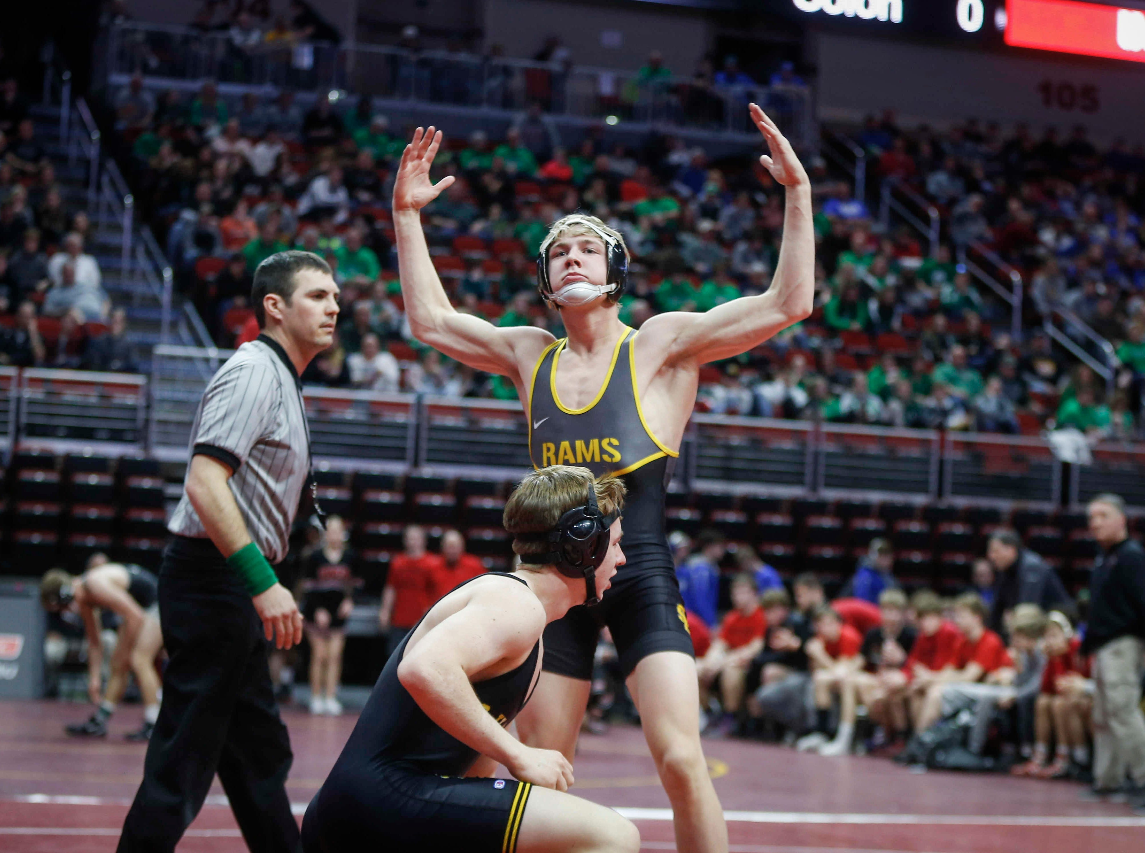 Southeast Polk's Lance Runyon celebrates after a 9-second win by fall over Waverly-Shell Rock's Kurt Fay at 152 pounds during the 2019 Iowa high school dual wrestling state tournament on Wednesday, Feb. 13, 2019, at Wells Fargo Arena in Des Moines.