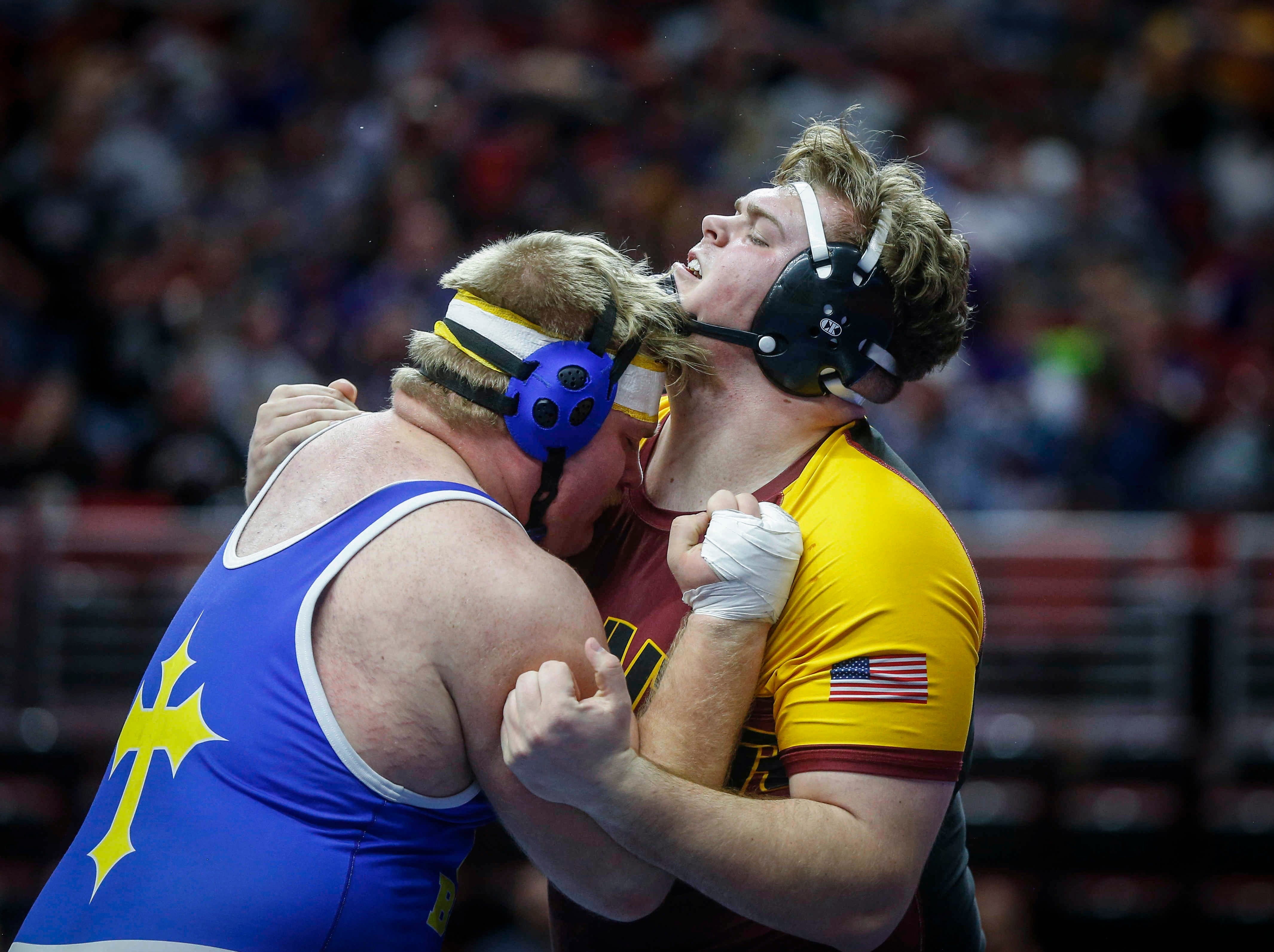 Denver senior Brock Farley, right, clashes with Don Bosco senior Noah Pittman in their match at 285 pounds during the opening round of Class 1A matches during the Iowa high school state wrestling tournament at Wells Fargo Arena on Thursday, Feb. 14, 2019, in Des Moines.