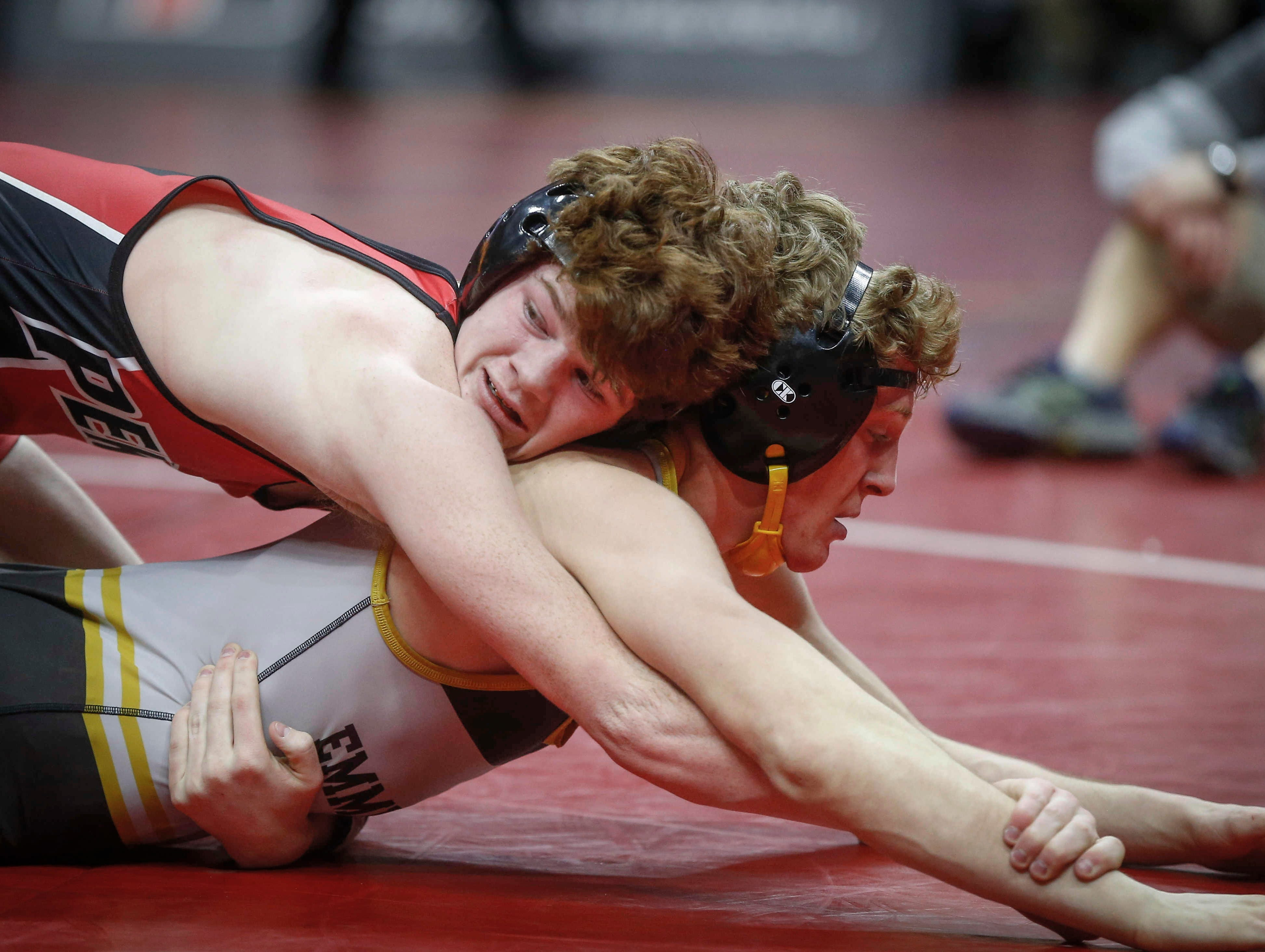 Pekin sophomore Cael Baker, top, controls Emmetsburg senior Spencer Griffin in their match at 145 pounds during the opening round of Class 1A matches during the Iowa high school state wrestling tournament at Wells Fargo Arena on Thursday, Feb. 14, 2019, in Des Moines.