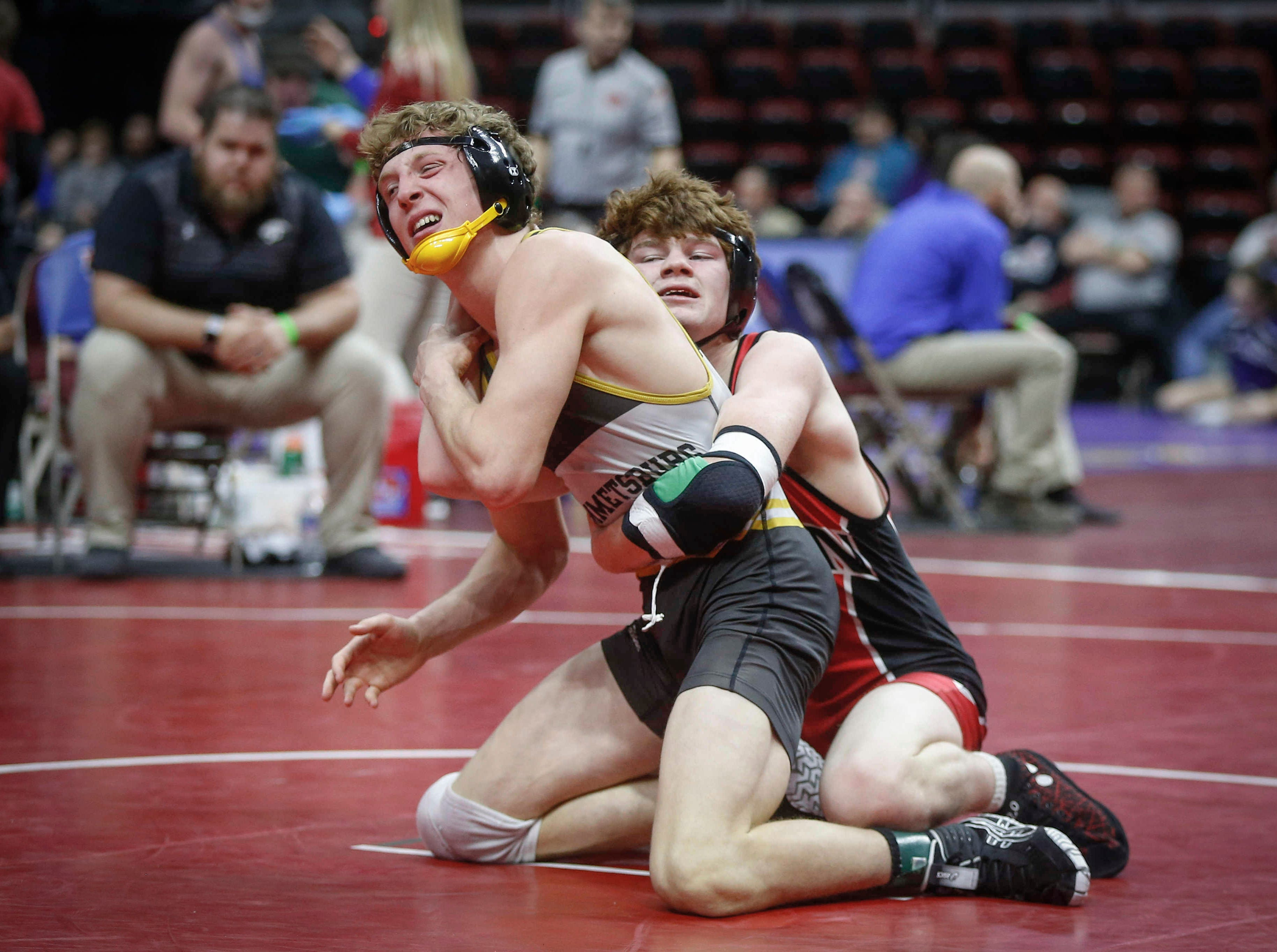Pekin sophomore Cael Baker, right, fights to keep Emmetsburg senior Spencer Griffin on the mat in their match at 145 pounds during the opening round of Class 1A matches during the Iowa high school state wrestling tournament at Wells Fargo Arena on Thursday, Feb. 14, 2019, in Des Moines.