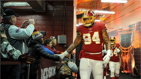 Washington Redskins linebacker Preston Smith walks out of the tunnel to start the game against the New York Giants on Dec. 9, 2018, at FedEx Field in Landover, Md.