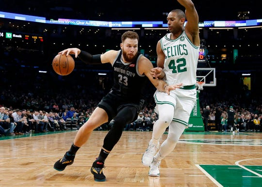 Blake Griffin drives on Celtics center Al Horford during the second quarter.