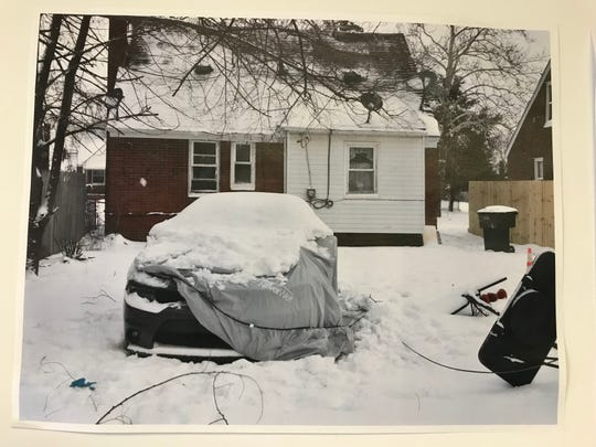 A photo of a 2018 Dodge Charger covered with a tarp in Detroit -- a car that Warren Police said hit a bicyclist who was crossing Groesbeck, killing him, in Warren on Feb. 3, 2019.