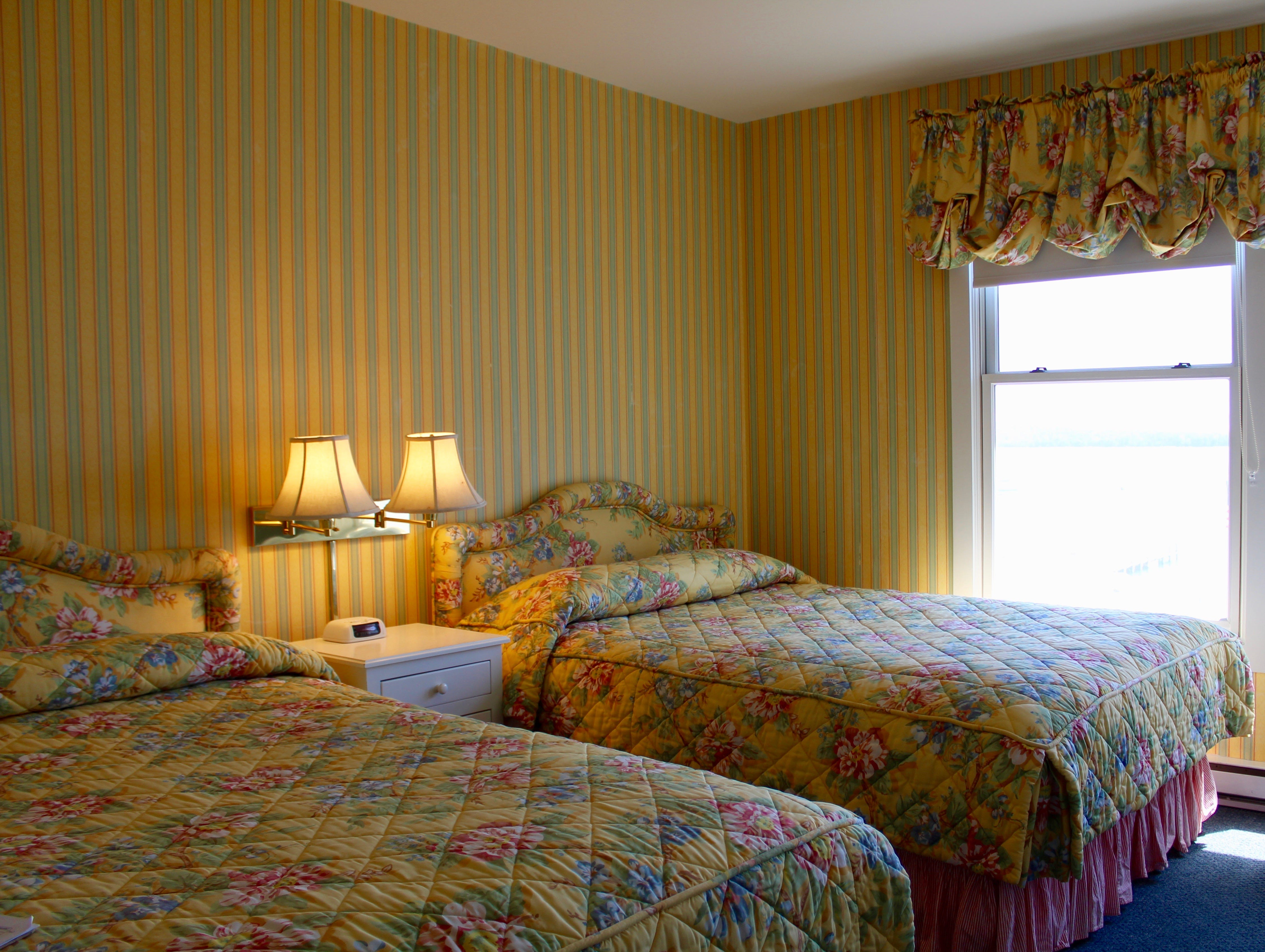 Pictured is one of the Island House Hotel rooms before renovations. The rooms were part of a four-year, $4 million, project at the Mackinac Island Historic Waterfront Hotel. The renovations included installing hardwood and adding phone charging stations.