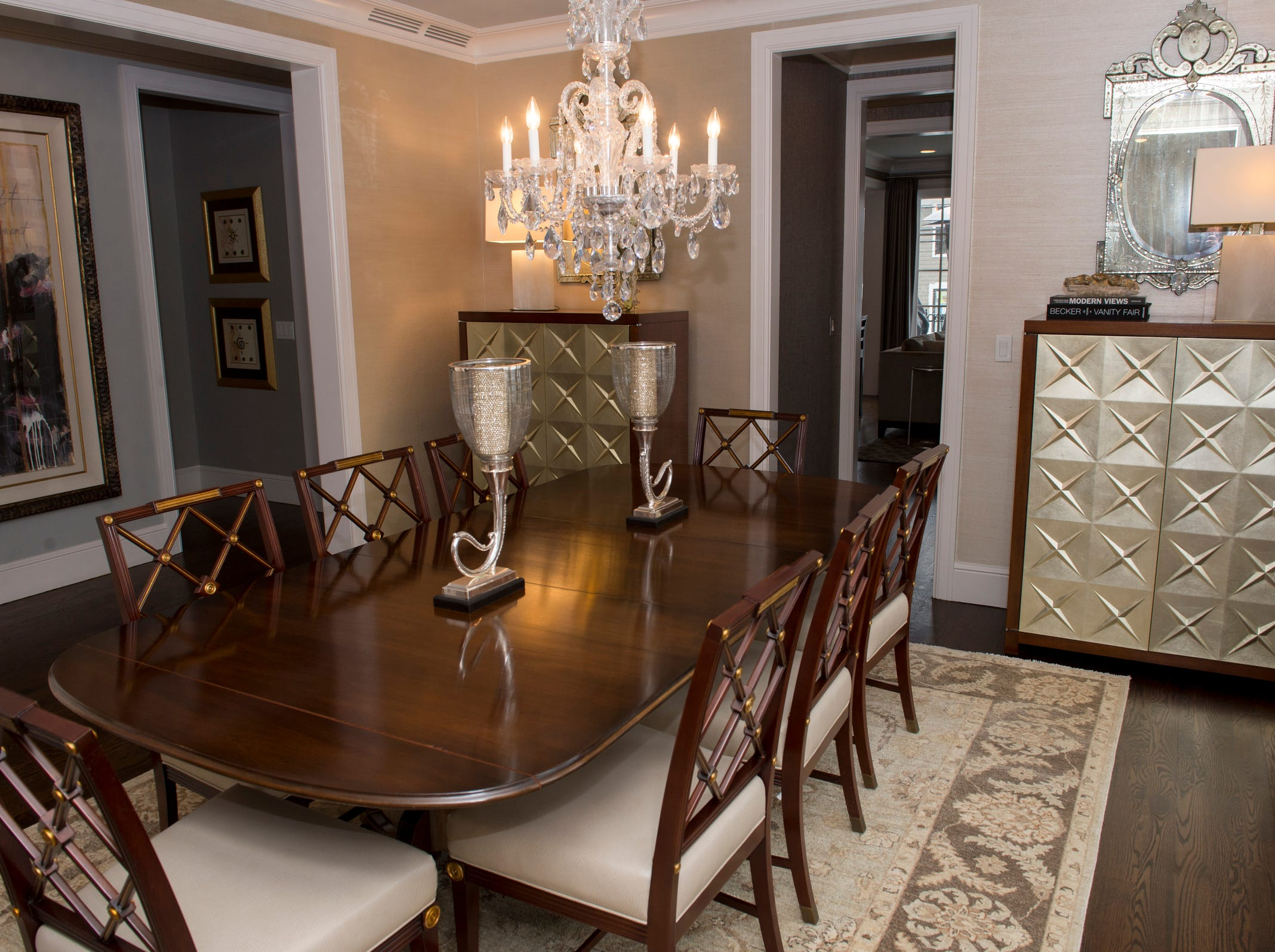 The dining room is fully furnished with matching cabinets.
