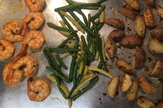 Today's sheet-pan dinner includes shrimp, green beans and potatoes.