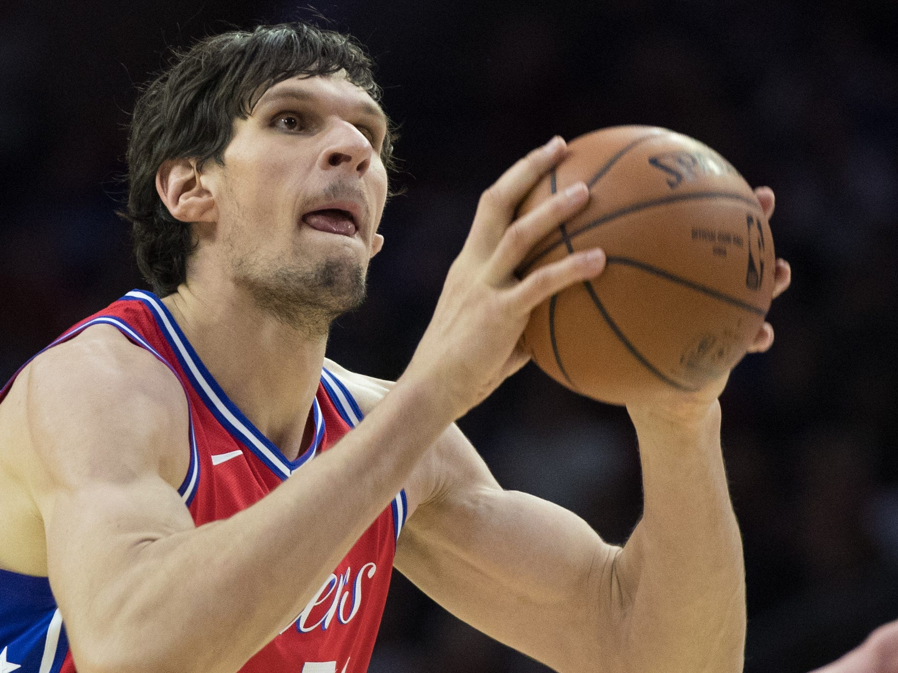 Philadelphia 76ers center Boban Marjanovic shoots against the Denver Nuggets in Philadelphia, Feb. 8, 2019.