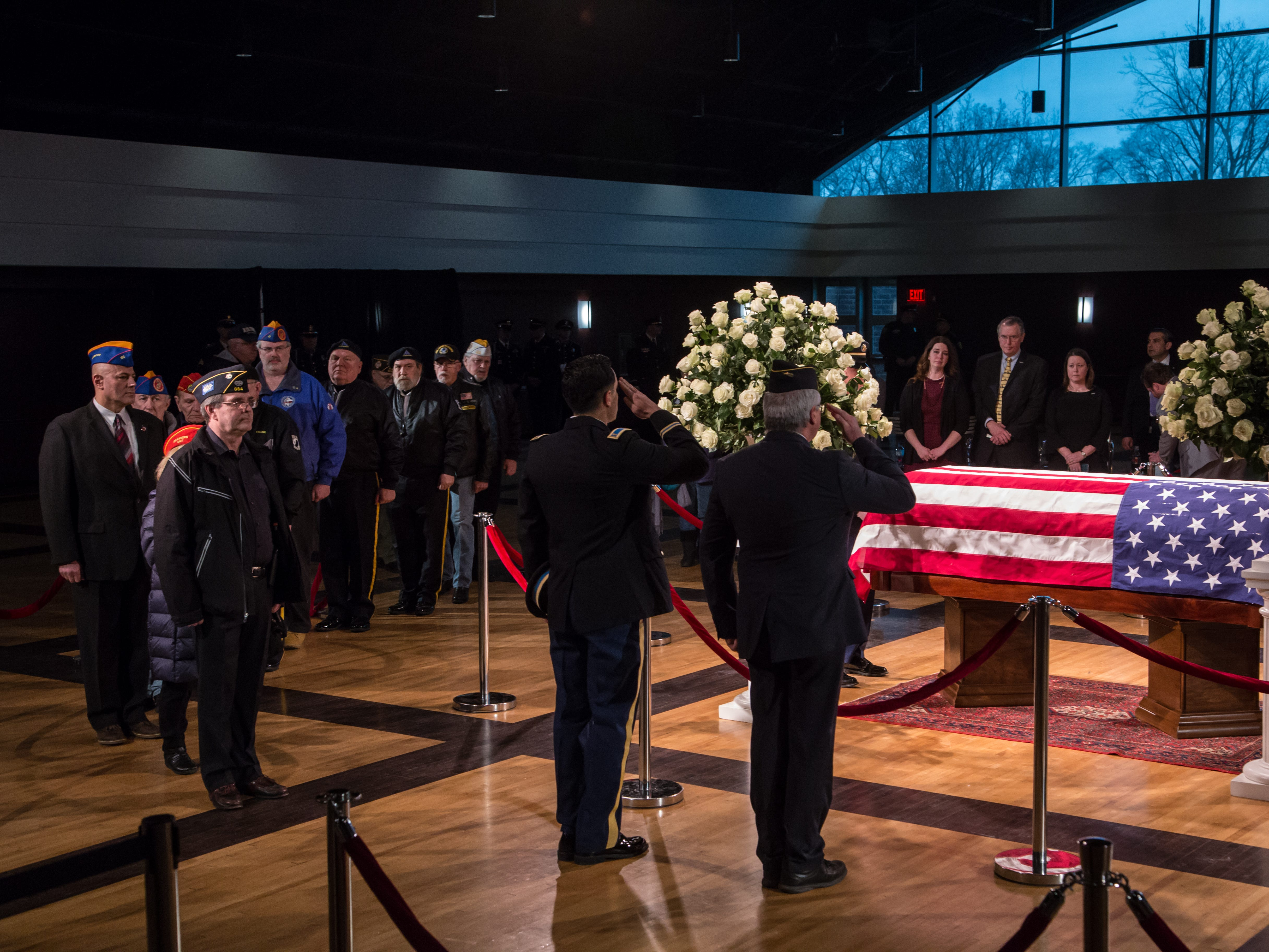 Members of the American Legion Fort Dearborn Post 364 stand at the casket of the late former US Representative John D. Dingell during his visitation at the Ford Community and Performing Arts Center in Dearborn on Monday, February 11, 2019.