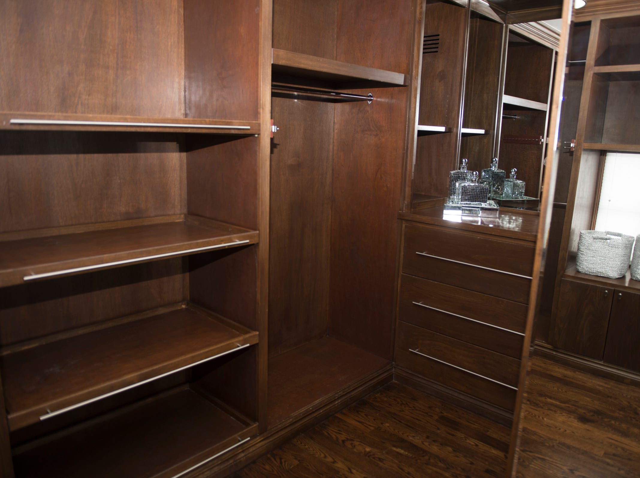 The master bedroom's closet is spacious with plenty of shelving.