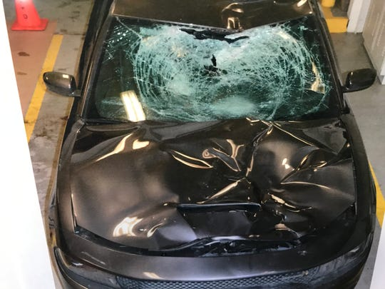Damage that Warren Police said was caused when the driver of this 2018 Dodge Charger hit a bicyclist, who was crossing Groesbeck, killing him, in Warren on Feb. 3, 2019.