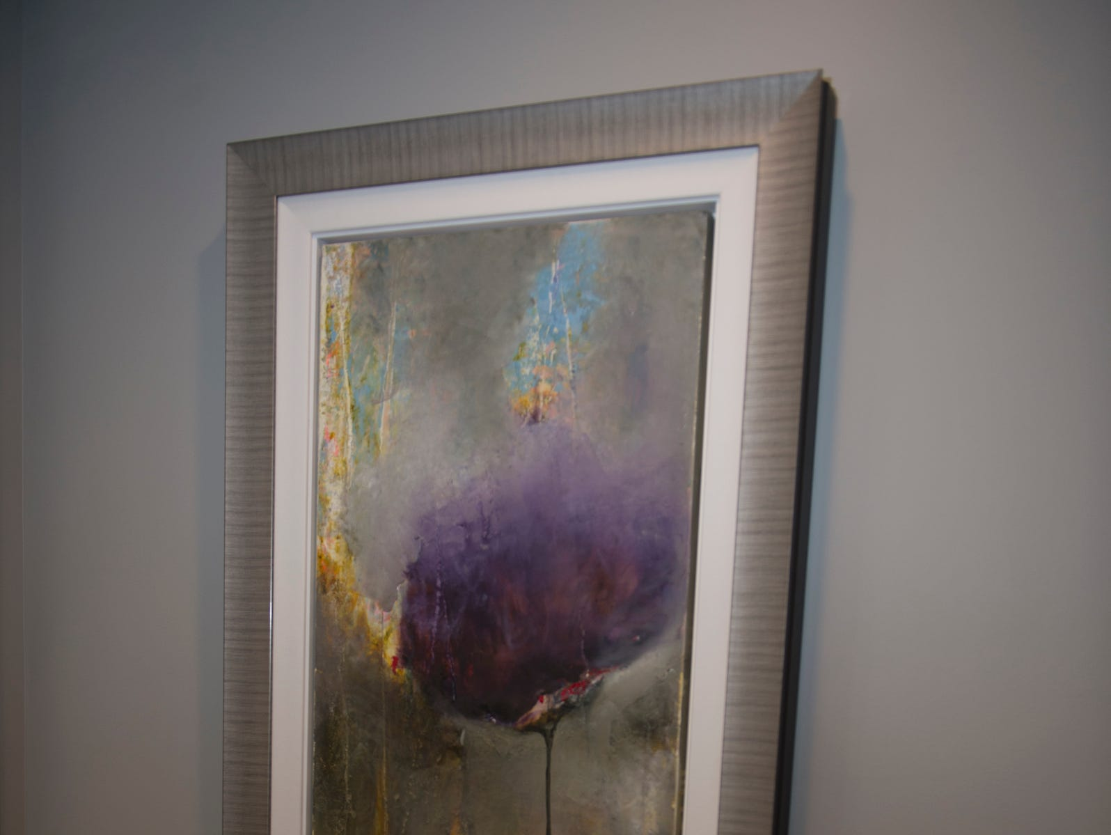 The townhouse includes several pieces of original art.