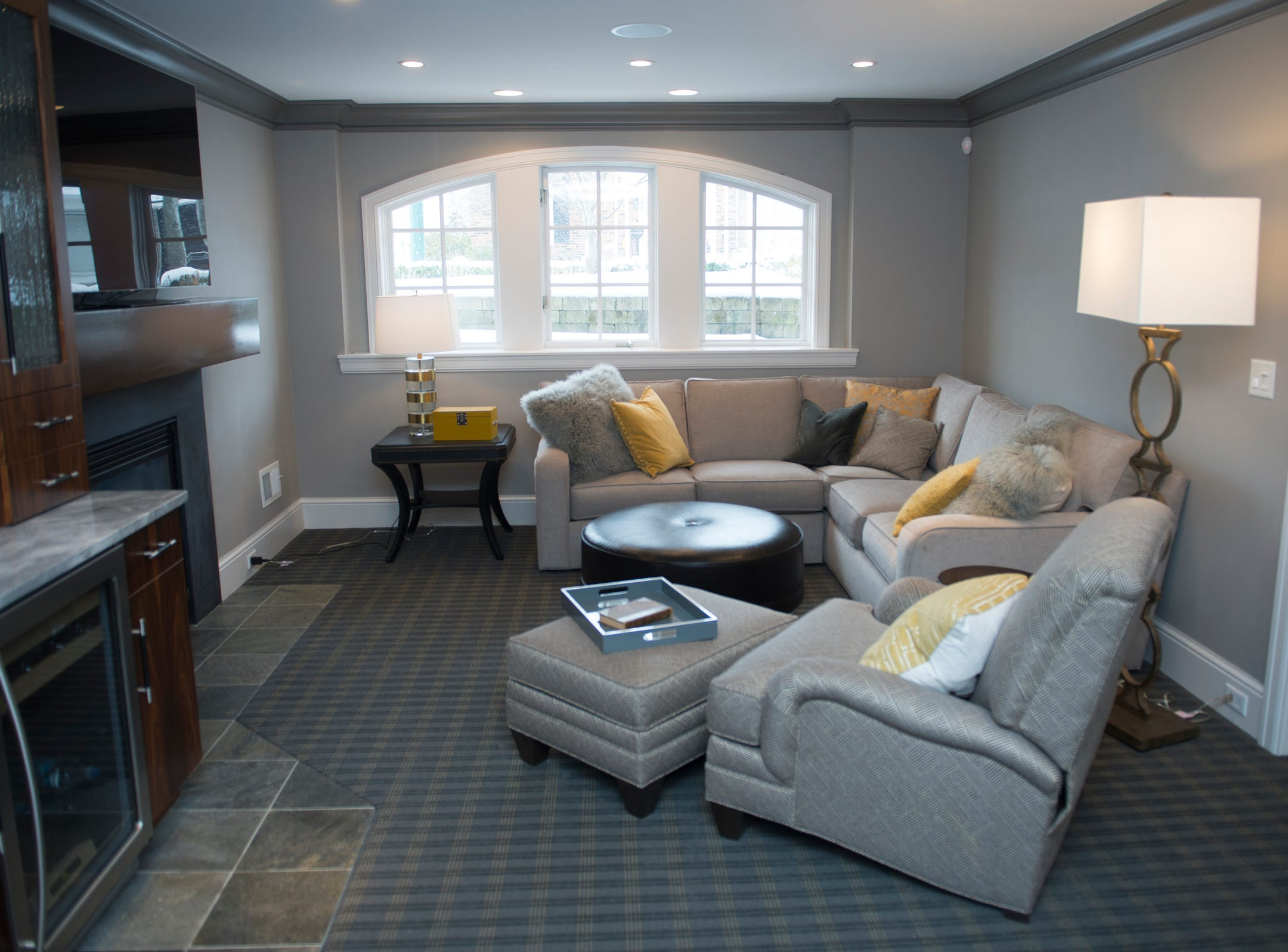 The basement hangout room includes a wet bar and fireplace.