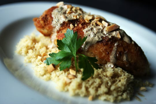 Chicken Frangelico served over coucous. A serving has 331 calories.