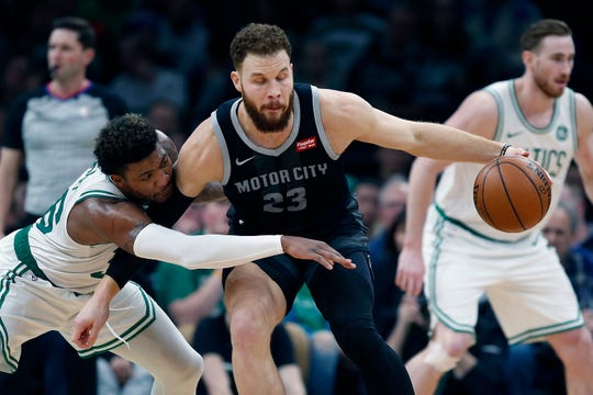 Marcus Smart, left, defends Blake Griffin during the first half.