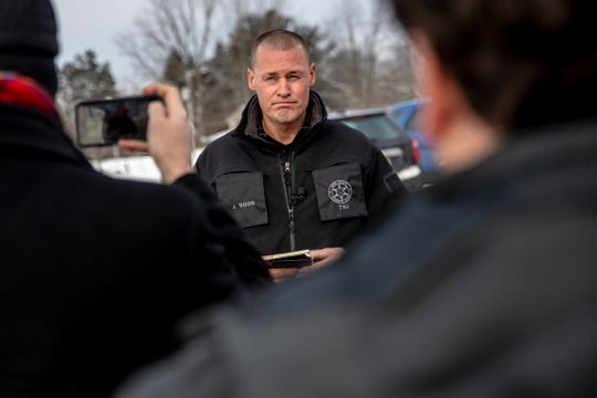 Kent County sheriff's Sgt. Joel Roon discusses the search for a missing snowmobiler during a press conference at the Spencer Township Fire Department, Thursday, Feb. 14, 2019 in Spencer Township, Mich. Authorities say a snowmobiler is missing at a lake in western Michigan and another snowmobiler was rescued from unstable ice at the lake. The Kent County sheriff's office responded Wednesday night to Lincoln Lake in Spencer Township following a 911 call from a person who reported he was riding with a man who apparently went into open water.