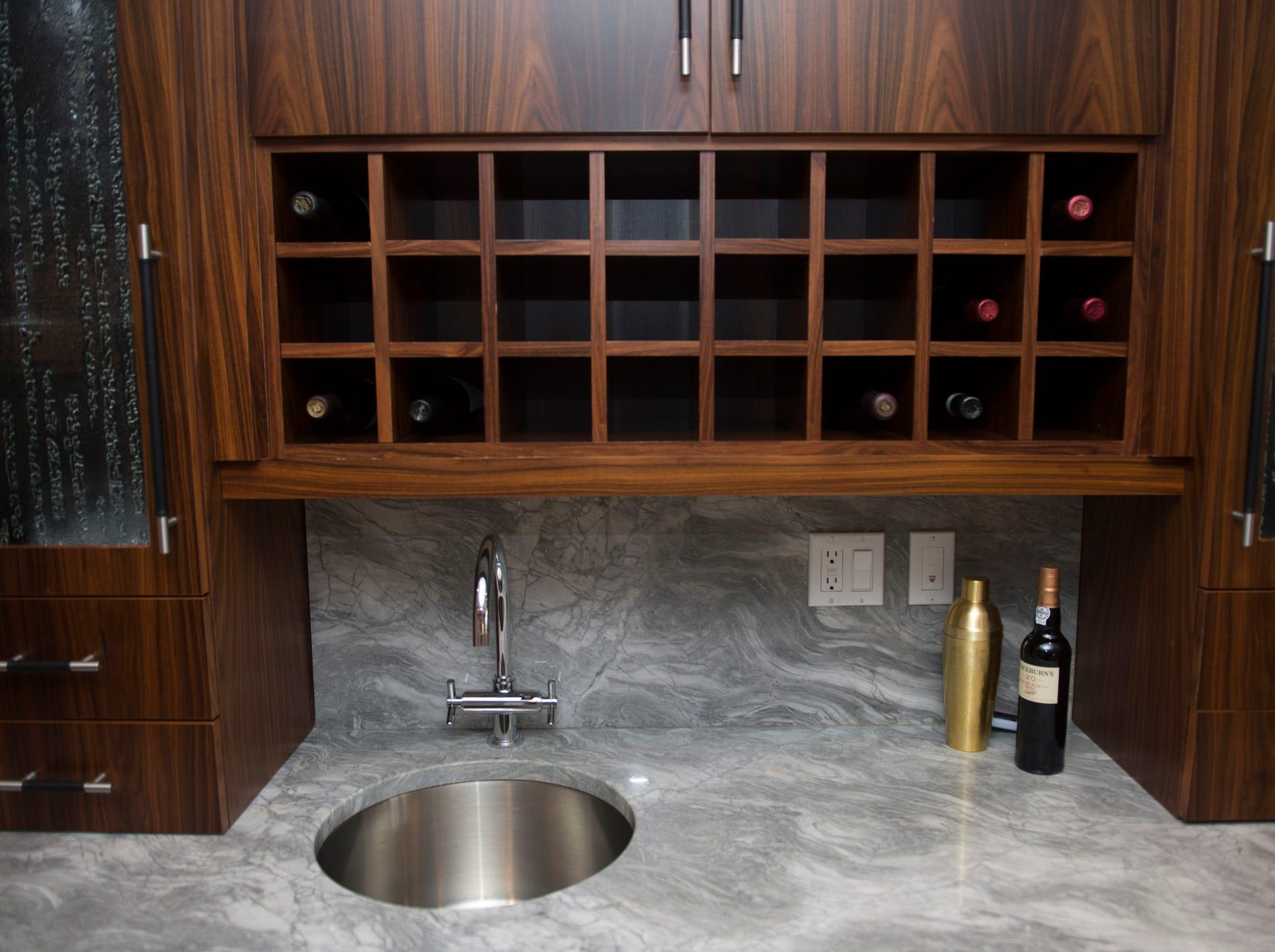 The basement hangout room includes a wet bar.
