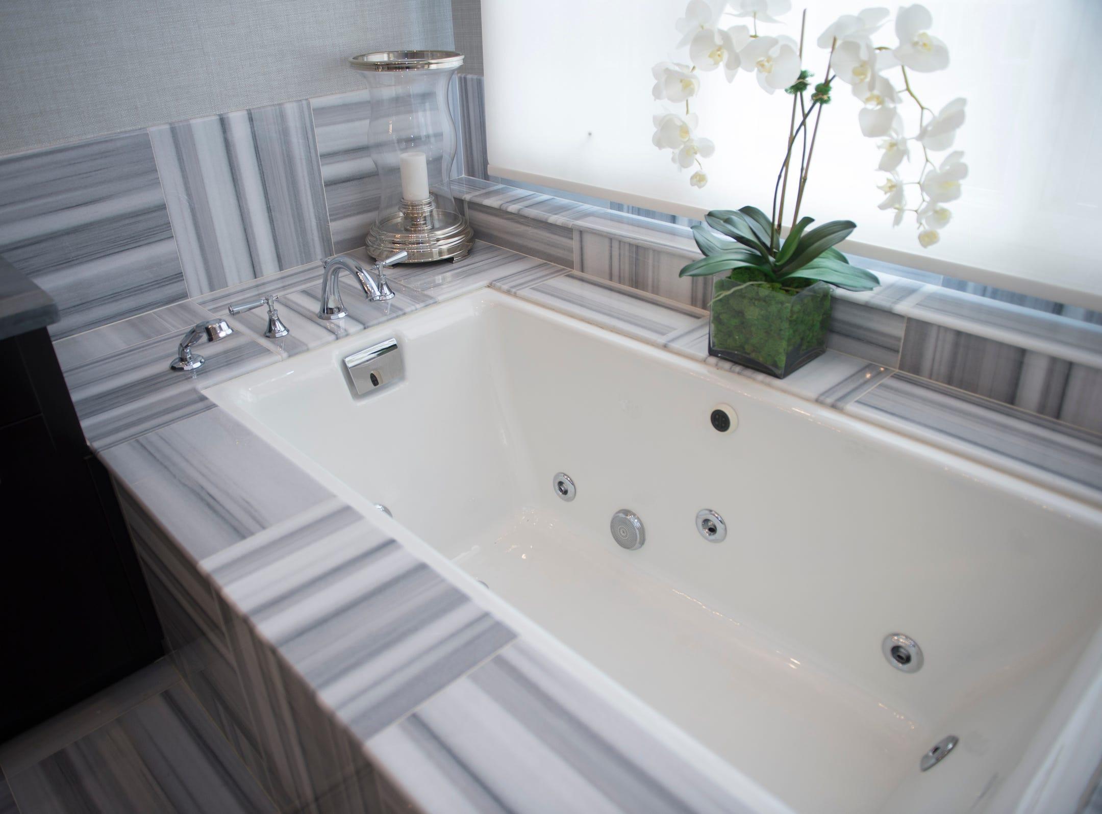 The master bathroom includes a hot tub.