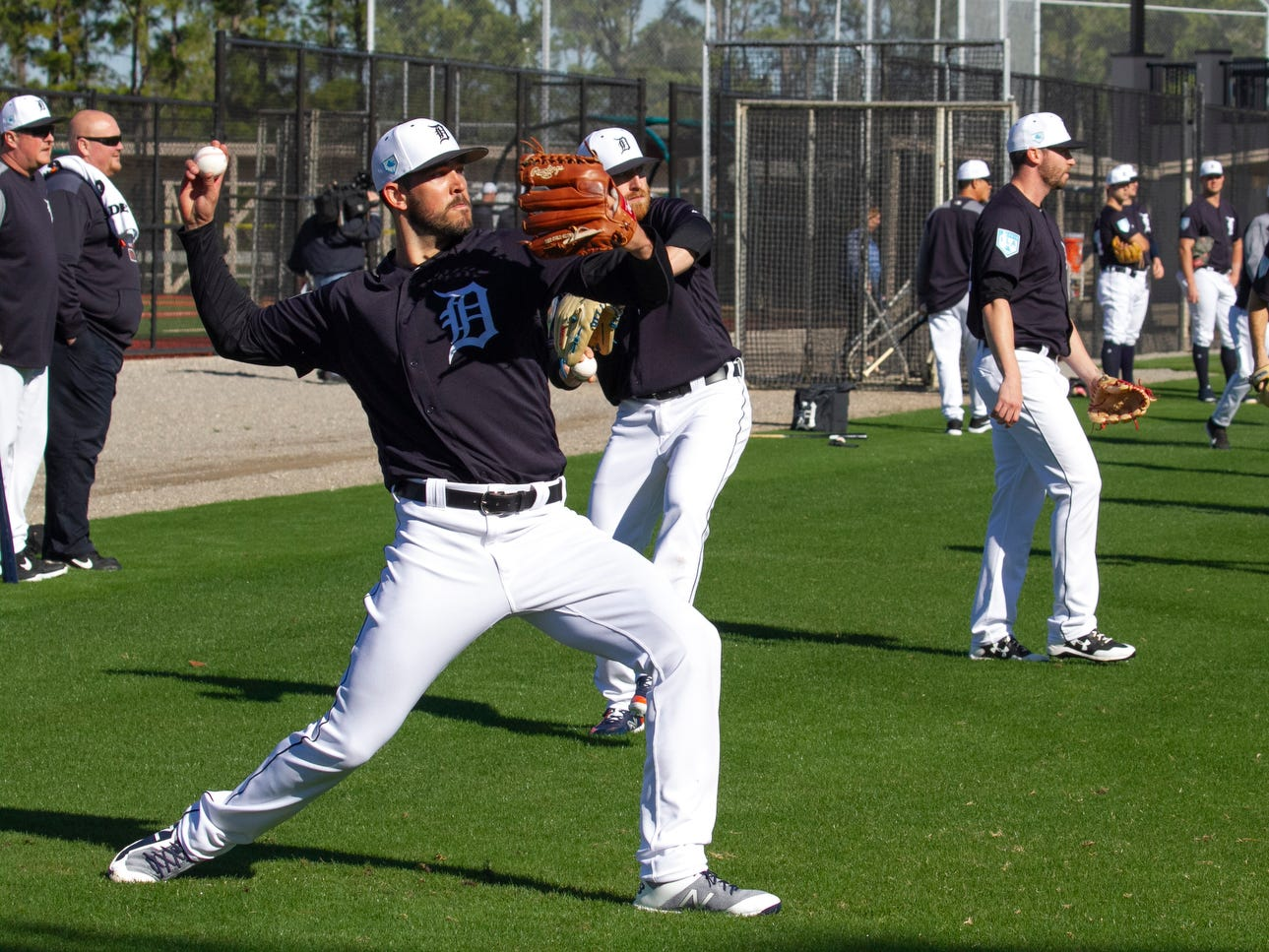 Detroit Tigers pitcher Drew VerHagen, left, and the pitching staff warm up.