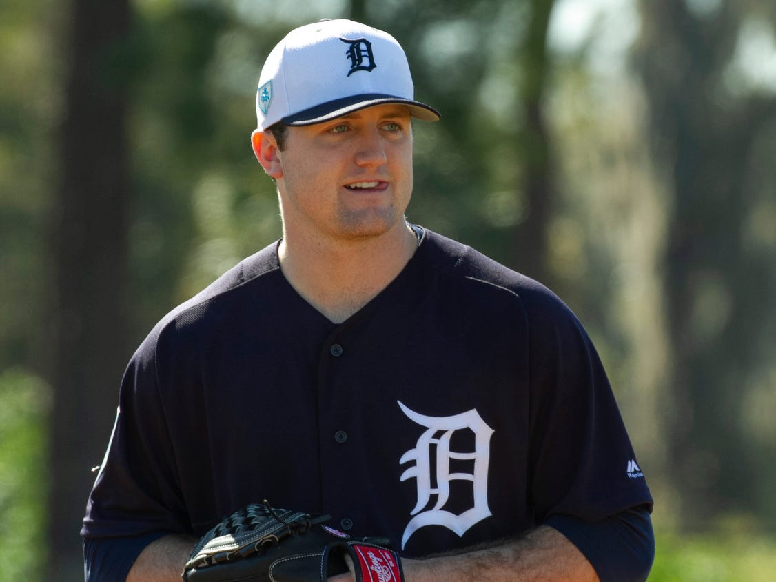 Detroit Tigers pitcher Casey Mize smiles as he takes fielding drills.