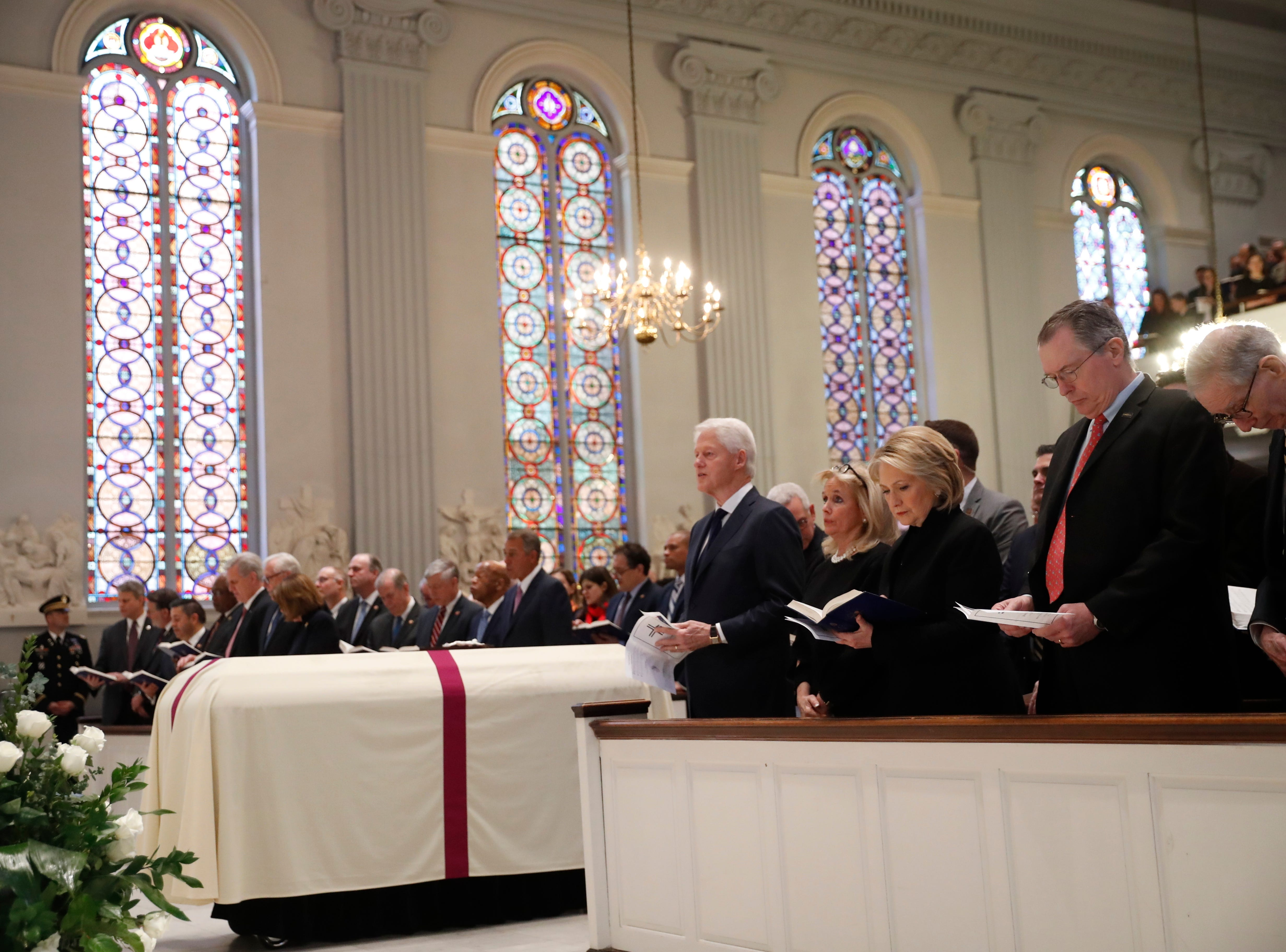 Rep. Debbie Dingell, D-Dearborn, center, stands with former President Bill Clinton and former Secretary of State Hillary Clinton, and other family members, during John Dingell's funeral in Washington, D.C.