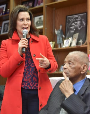 Michigan Gov. Gretchen Whitmer addresses attendees with Judge Damon J. Keith.